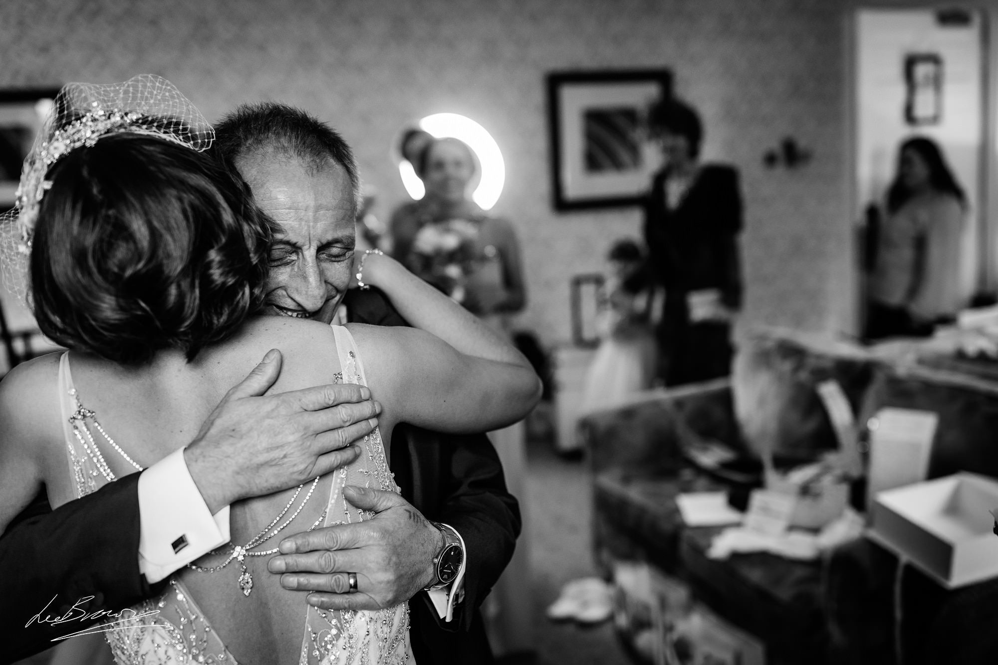 the brides dad hugging the bride