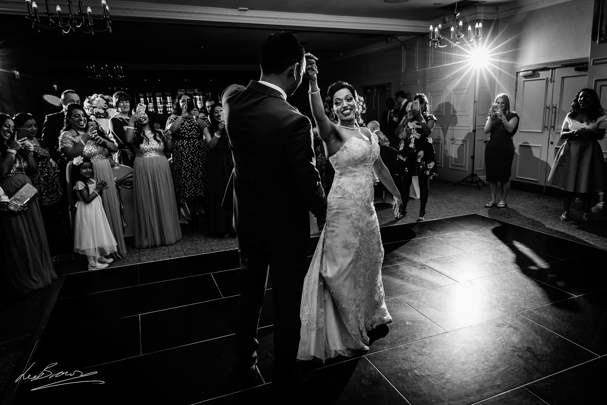 the couple dancing at mottram hall after their wedding