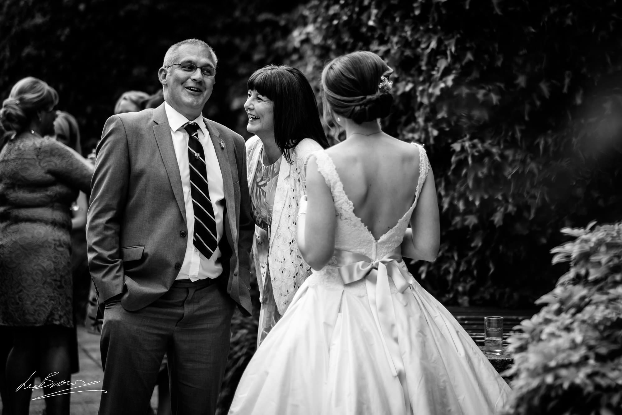 family chatting with bride