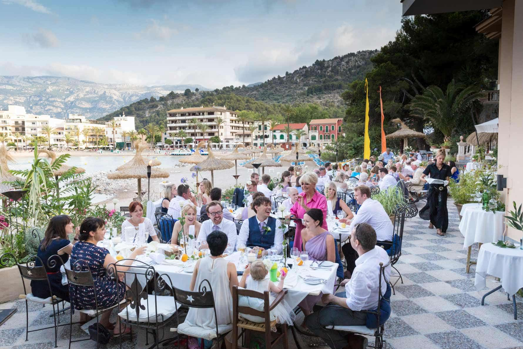"""Wedding breakfast over the bay"" by Mallorca wedding photographer in Port de Soller"