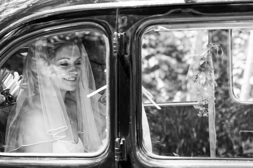 """""""Katie Arives"""" by Hampshire wedding photographer at The Barn at Bury Court wedding by Graham Warrellow"""