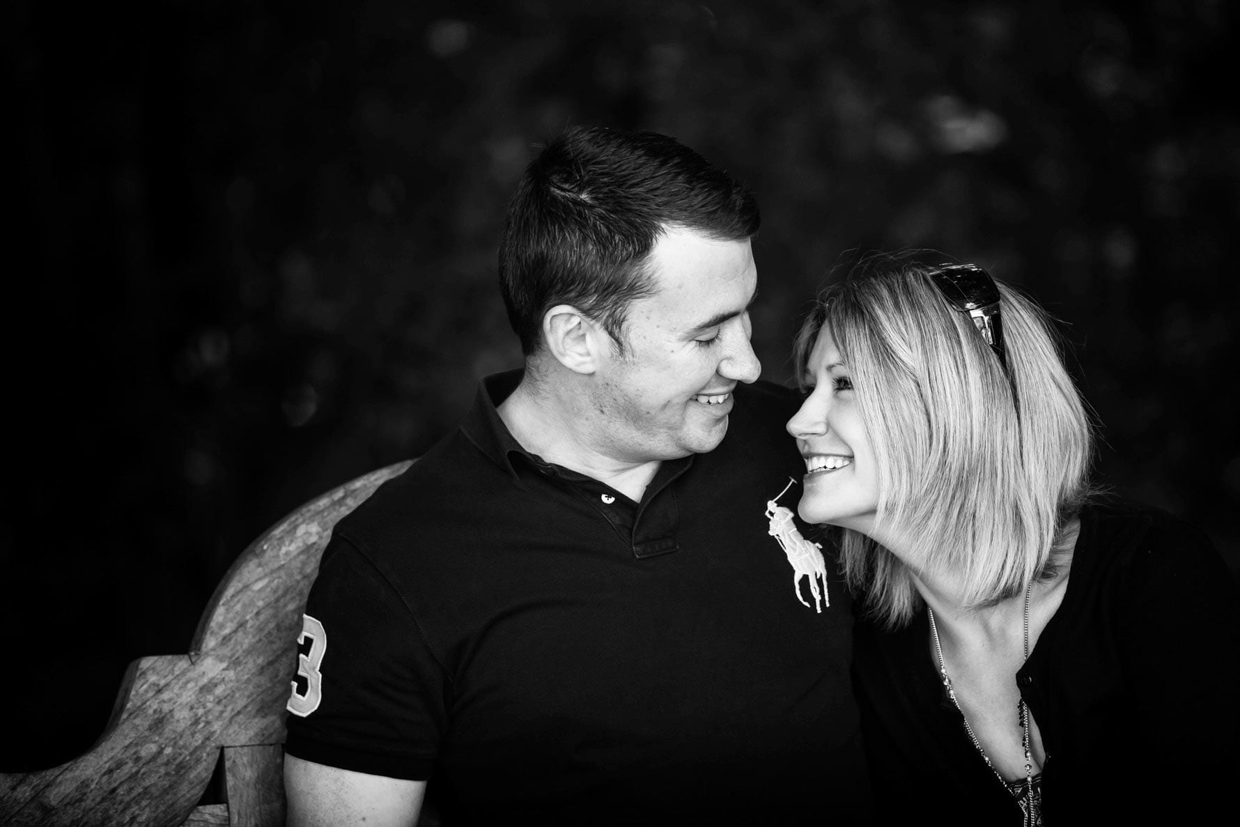 Katie & Dan smiling during an engagement photoshoot by Hertfordshire wedding photographer