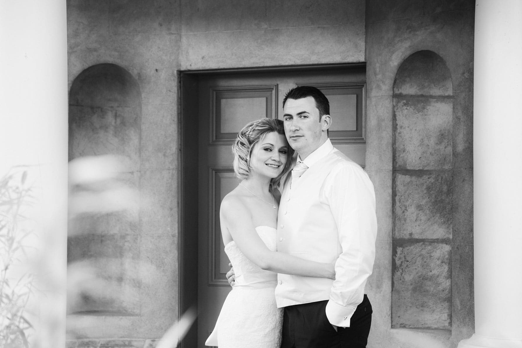 Portrait of Katie and Dan in the gardens at The Barn at Bury Court