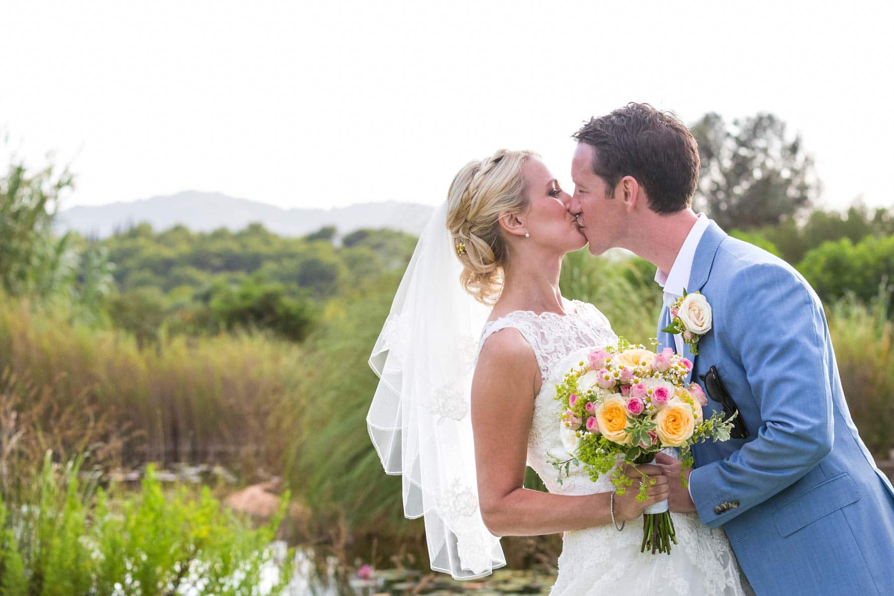 Bride and groom kissing after their Mallorca destination wedding in Capdepera