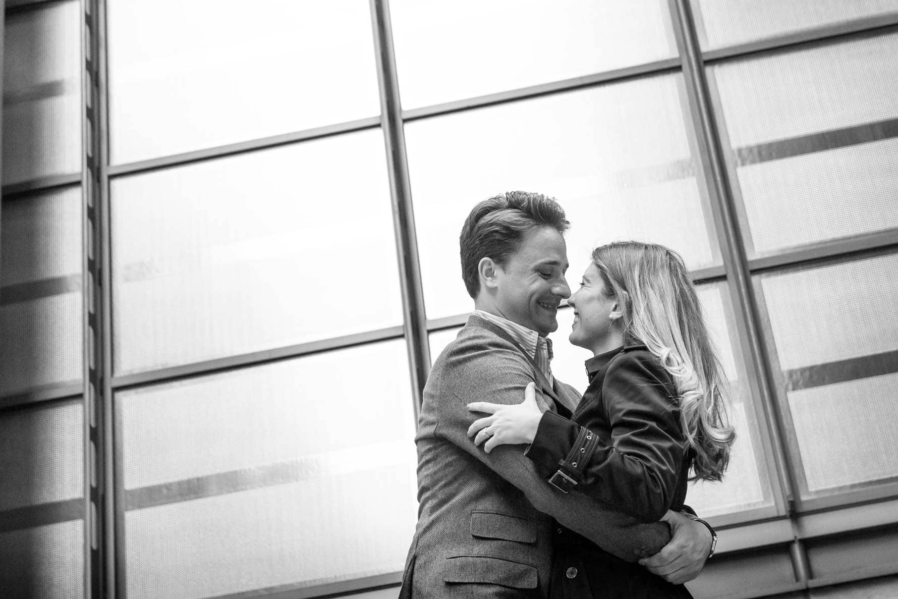 Hugging in Lime Street on a London engagement photoshoot