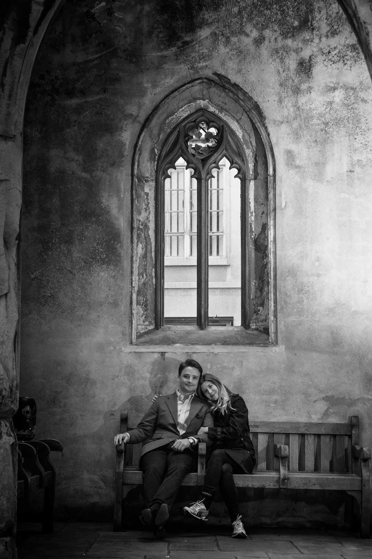 Cuddling on a bench in Paula and Oliver resting on a bench in St Dunstan-in-the-East