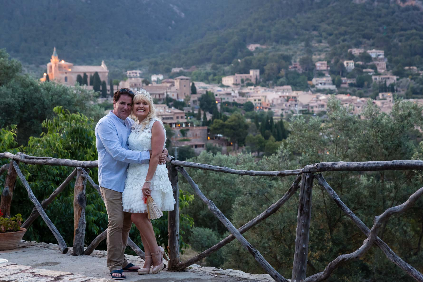 Happy couple at the end of their Mallorca wedding day overlooking Valldemossa wedding