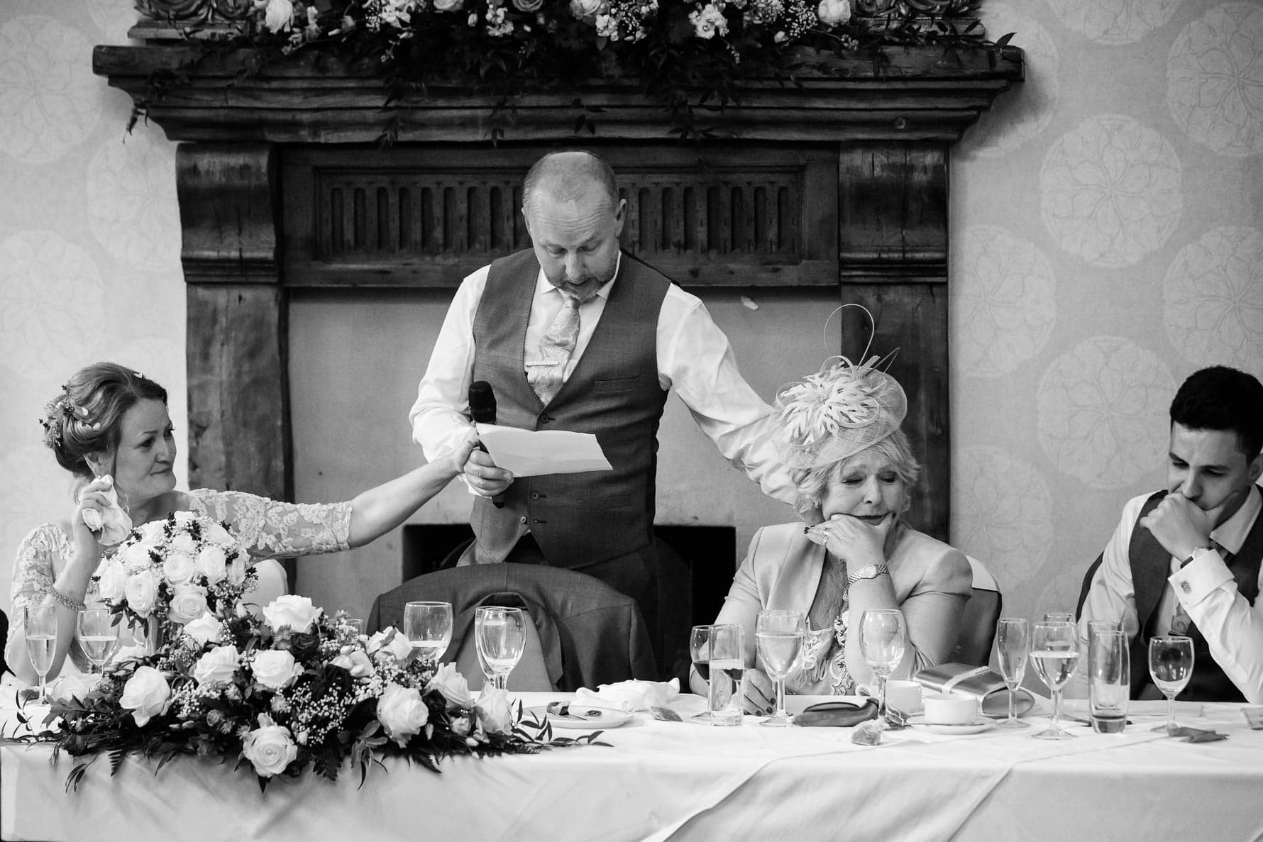A touching moment at Hanbury Manor wedding in Hertfordshire by documentary wedding photographer Graham Warrellow