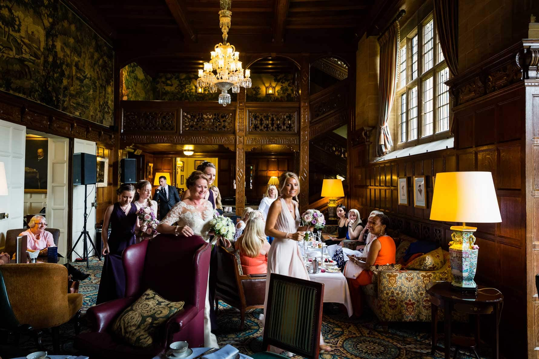 Bridal party walking through Hanbury Court Manor House to the wedding ceremony