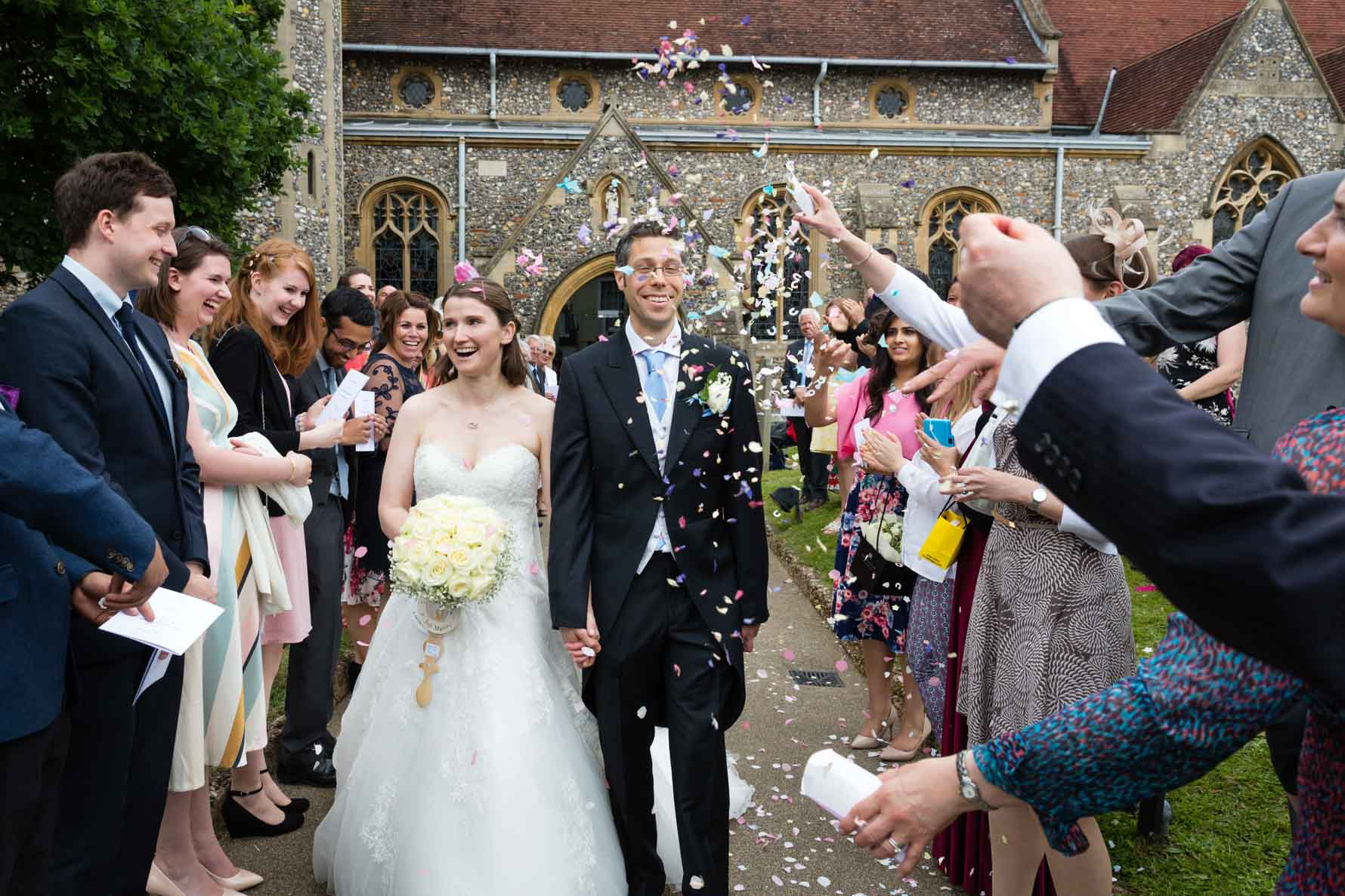 Throwing the confetti at Hertfordshire wedding in Welwyn village