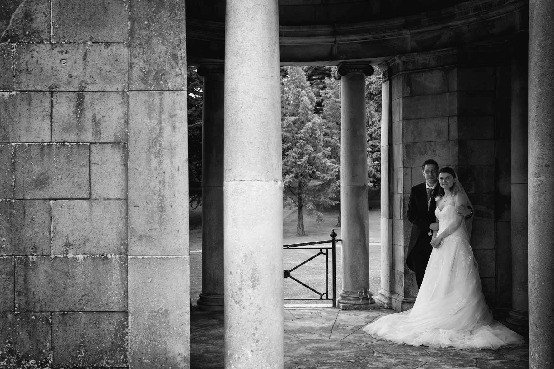 Bride and groom in grounds of Luton Hoo Hotel by Hertfordshire wedding photographer Graham Warrellow