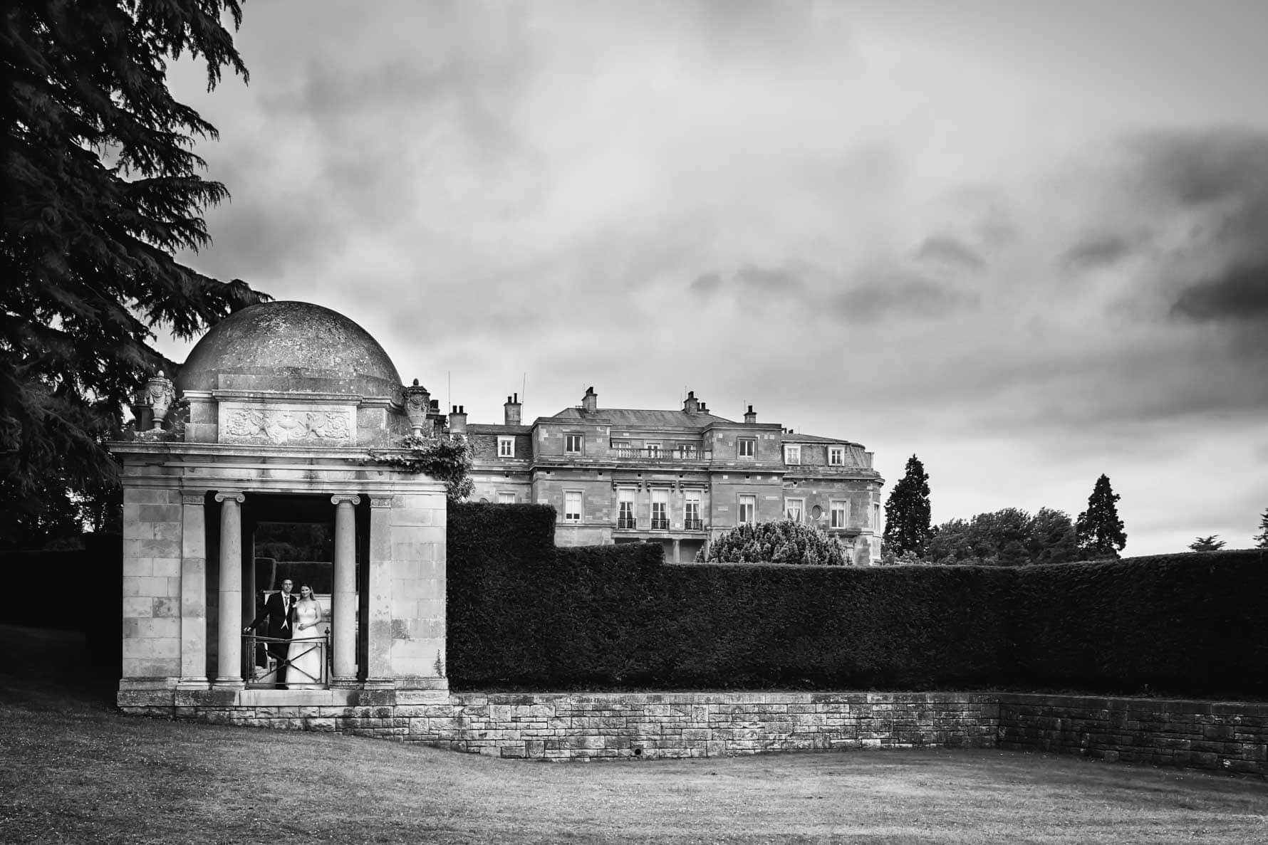 Bride and groom under stormy skies at Luton Hoo Hotel by Hertfordshire wedding photographer Graham Warrellow