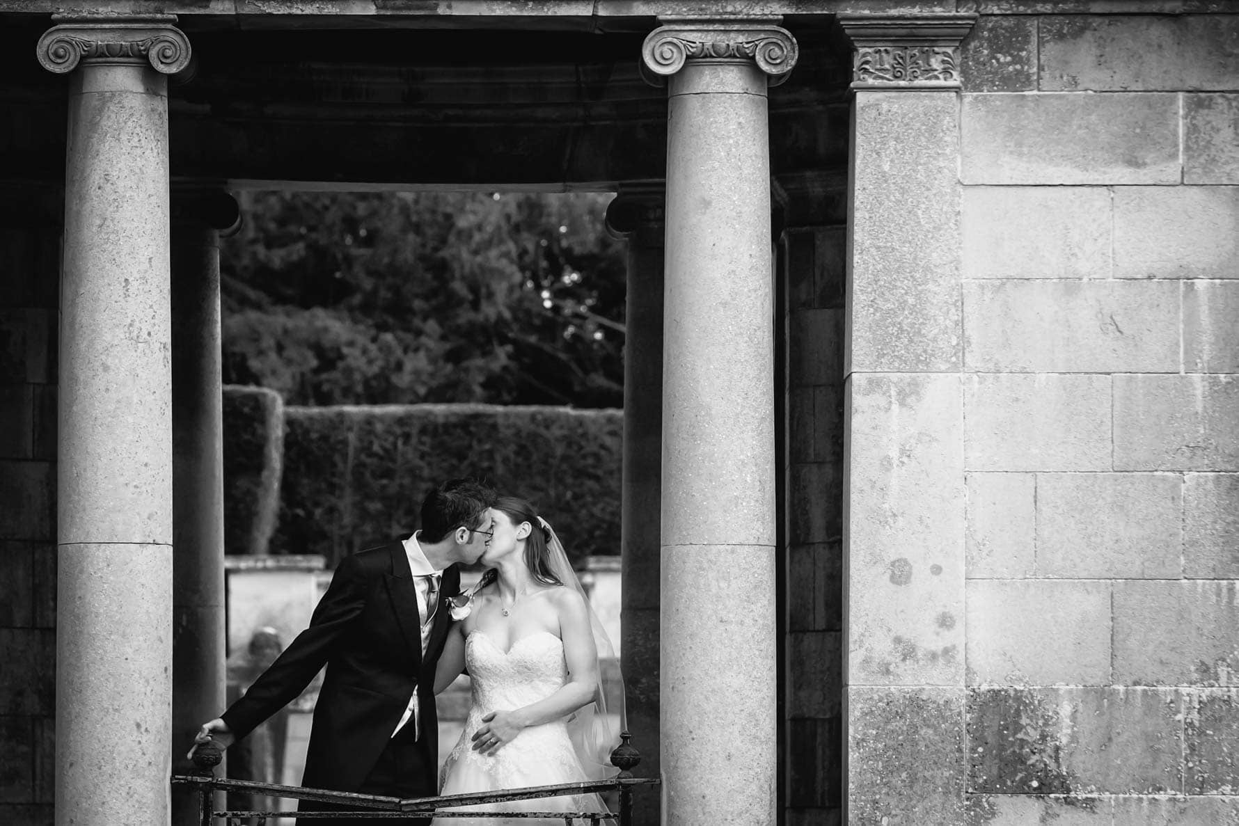Kissing at Luton Hoo Hotel by Hertfordshire wedding photographer Graham Warrellow