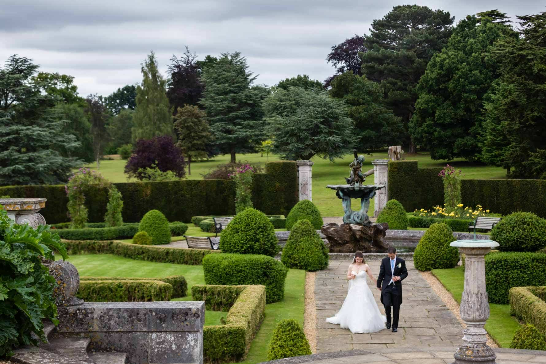 Bride and groom in the grounds of Luton Hoo Hotel in Bedfordshire