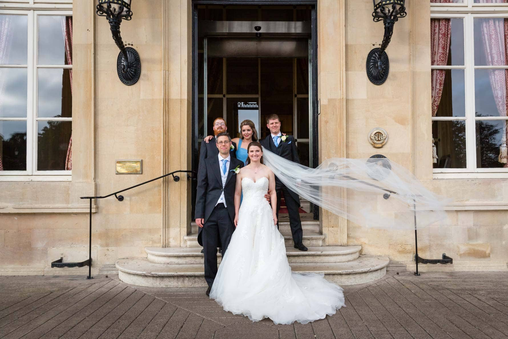 Bridal party on steps at Luton Hoo Hotel by Bedfordshire wedding photographer Graham Warrellow