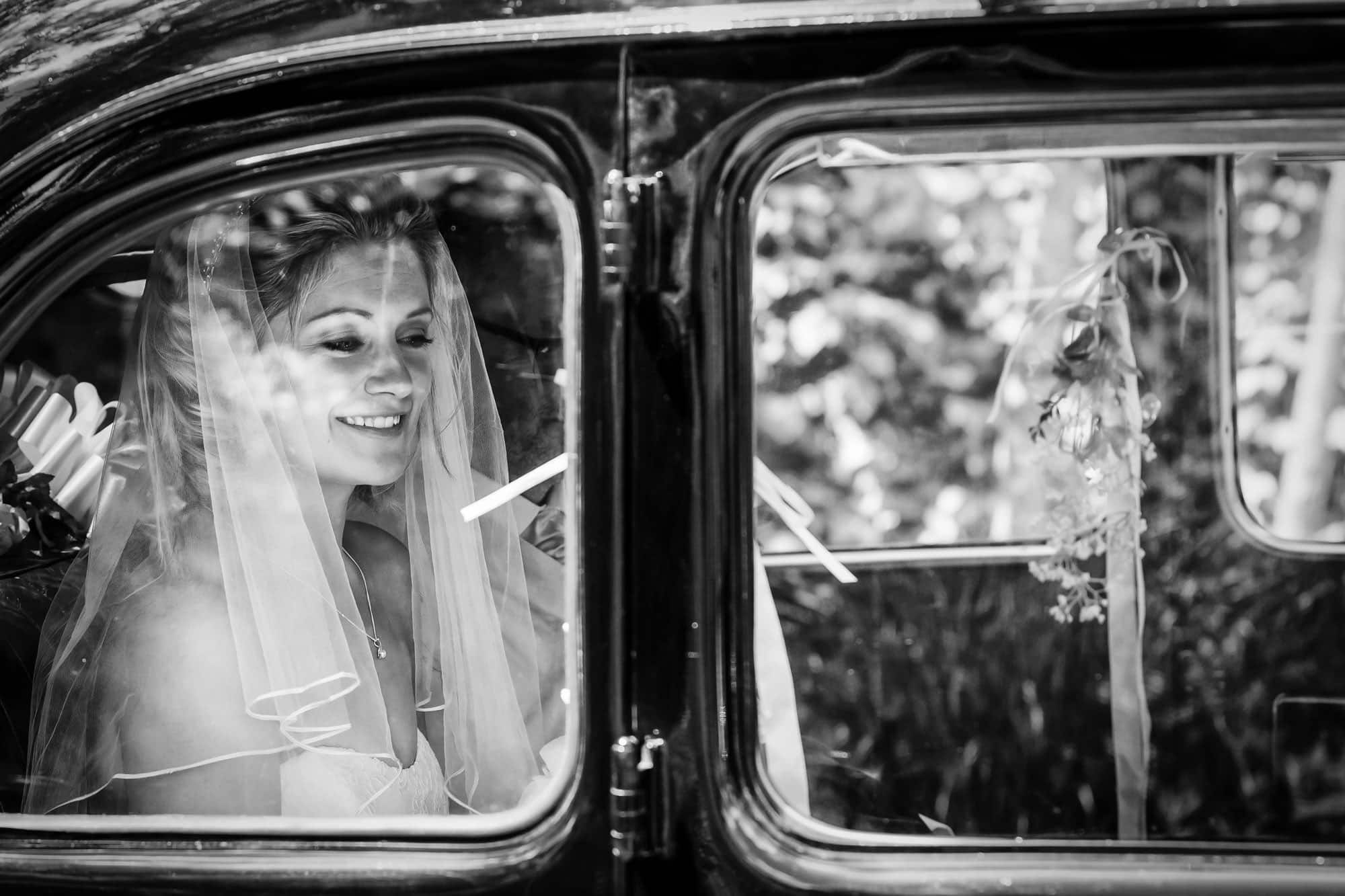 Bride arrives to her The Barn at Bury Court wedding in Hampshire