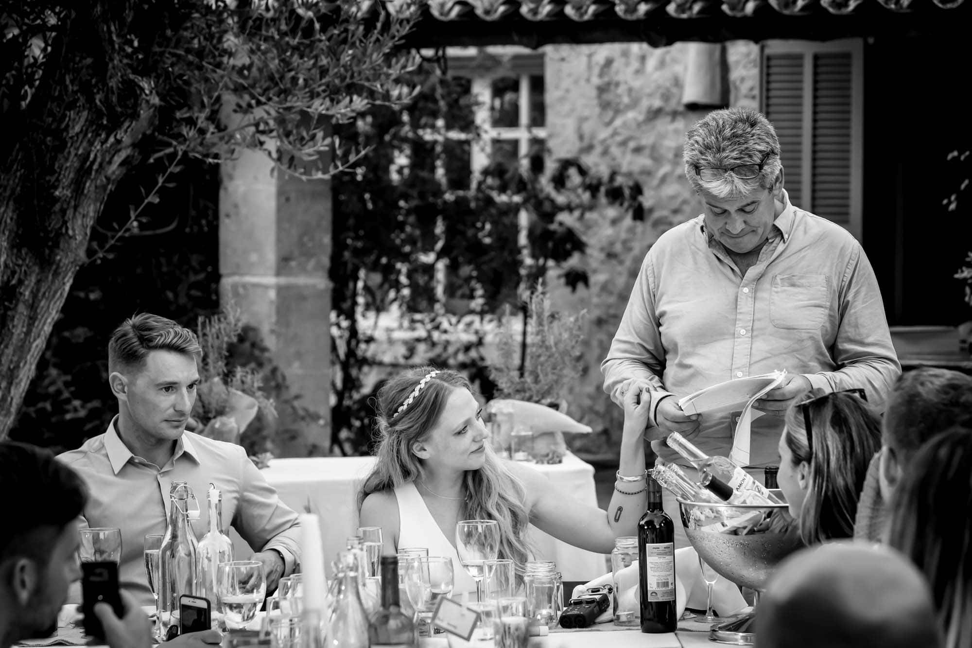 Cathy touches her dad's arm during his wedding speech by Mallorca wedding photographer Graham Warrellow