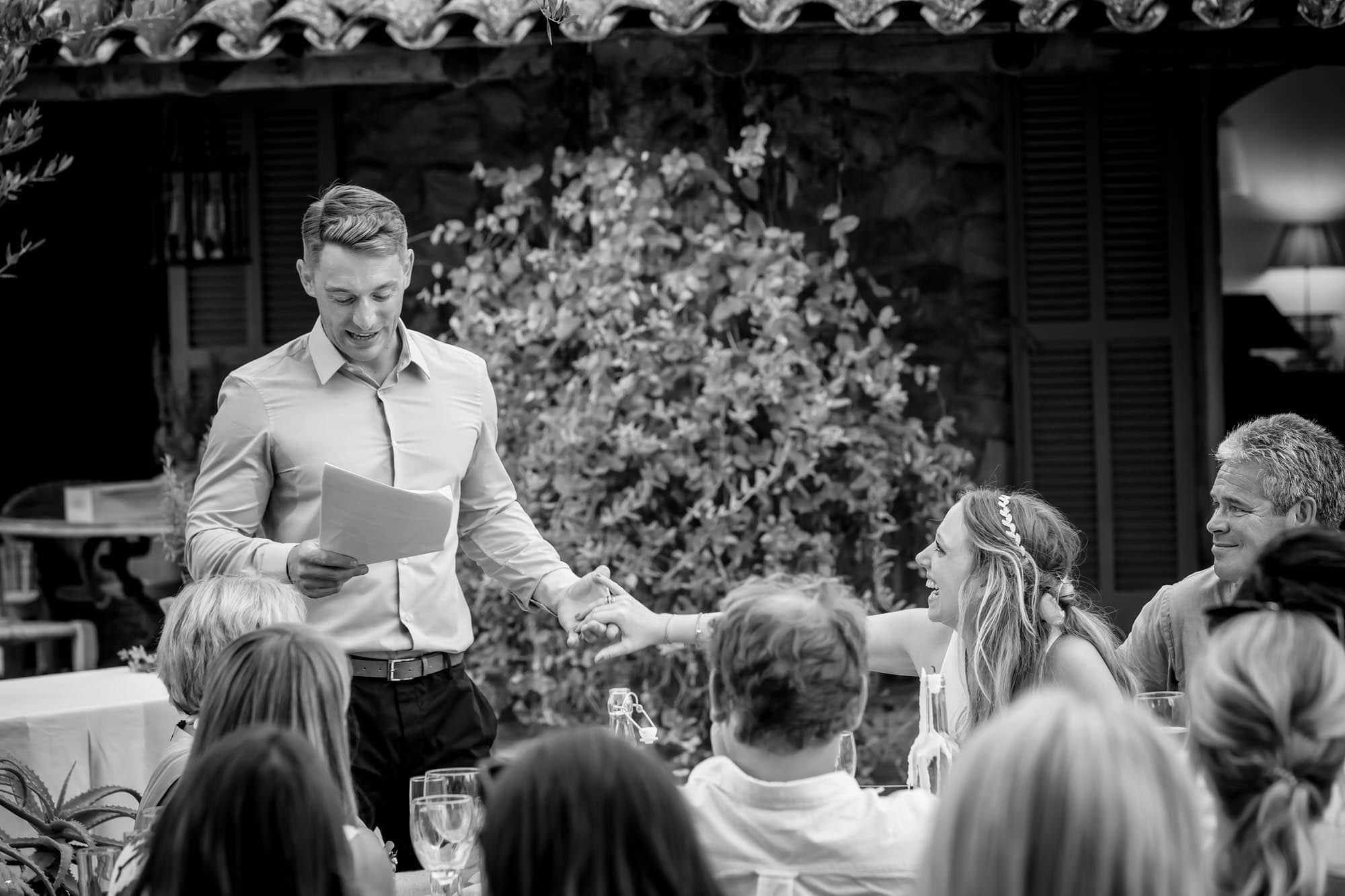 Cathy holds Ben's hand during his speech at their Mallorca finca wedding