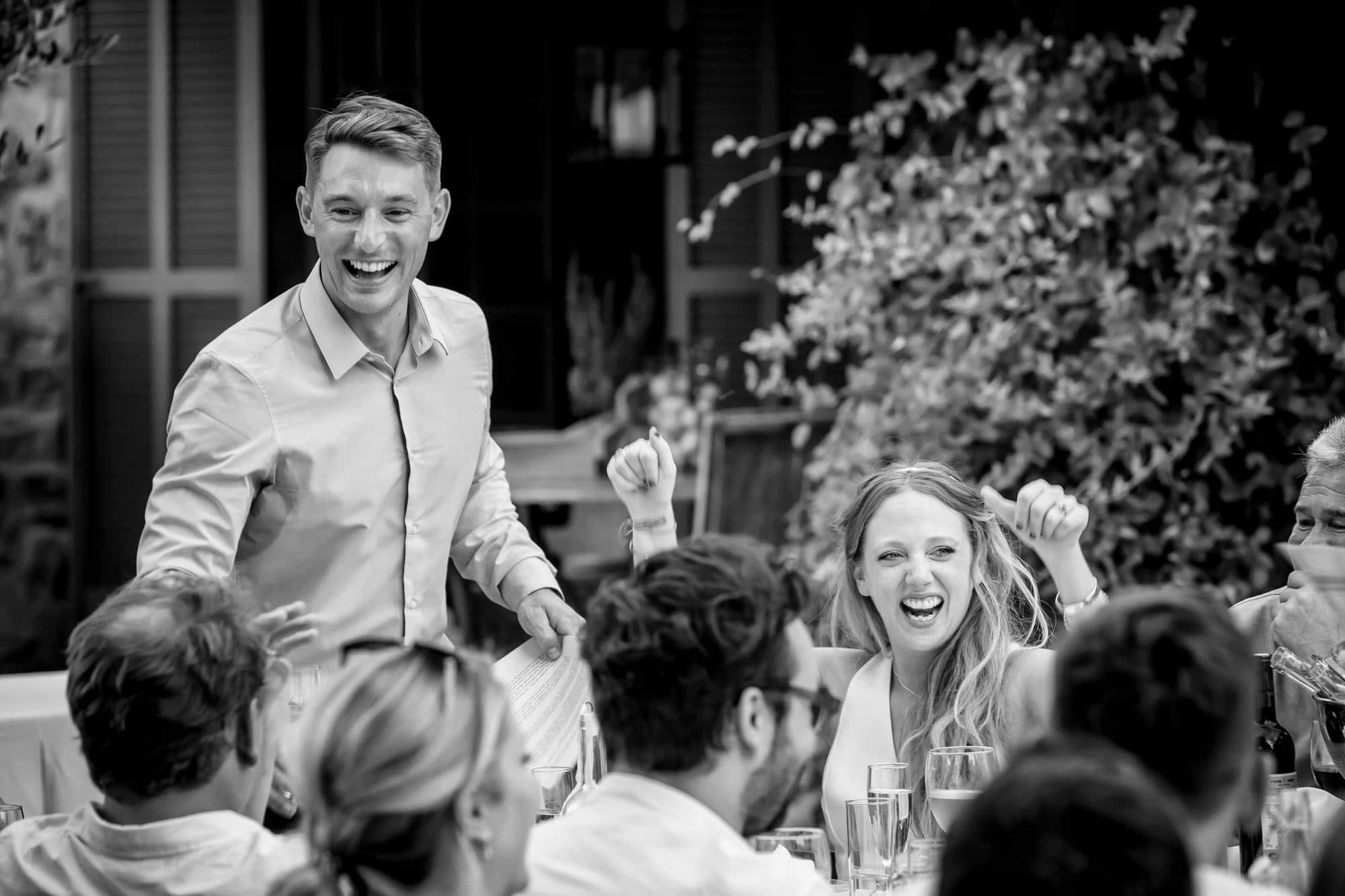A cheer of encouragement for Ben from Cathy during his speech at their finca wedding by Mallorca wedding photographer Graham Warrellow