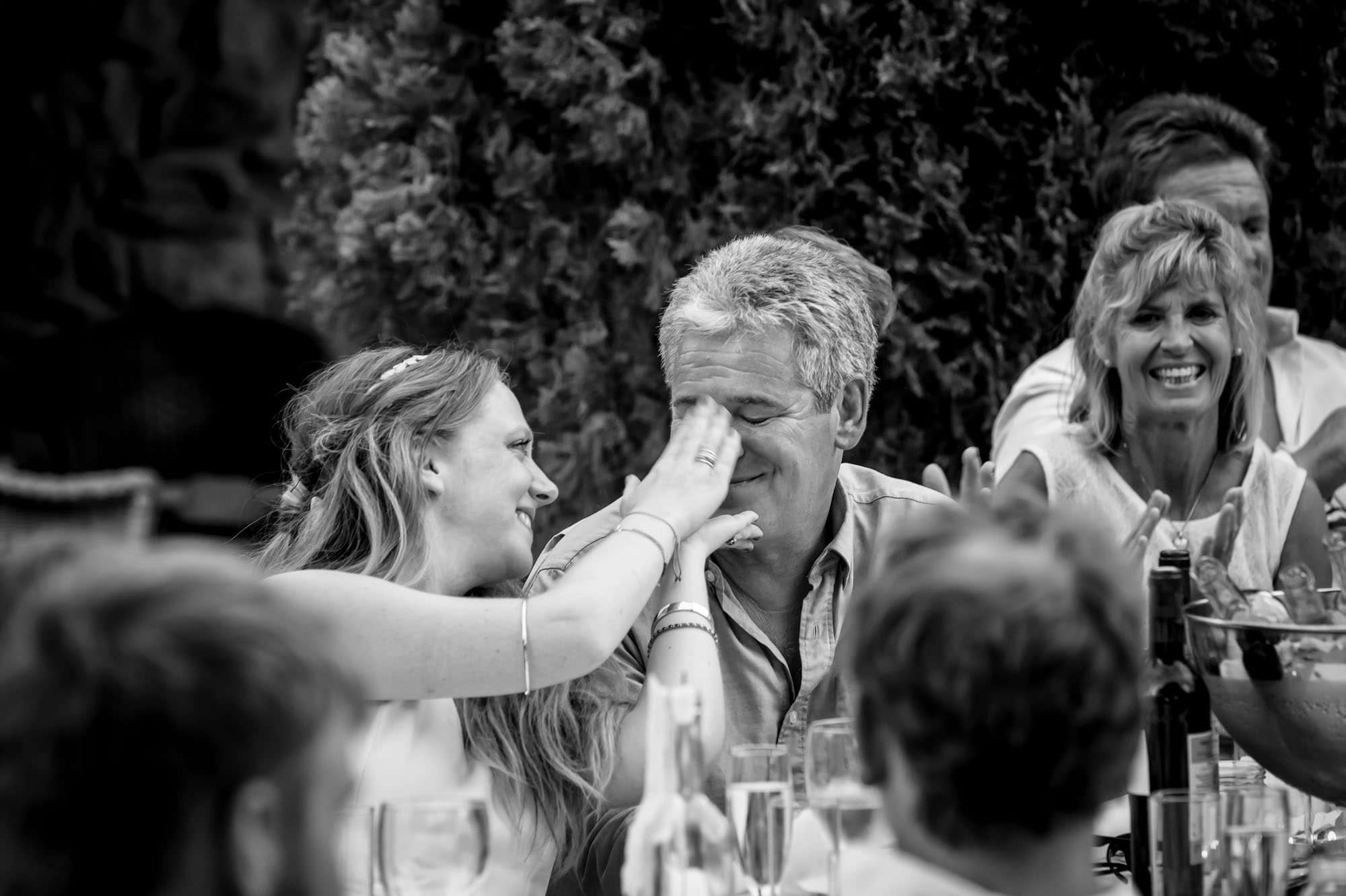 Cathy plays with her dad during the speeches at her Mallorca wedding
