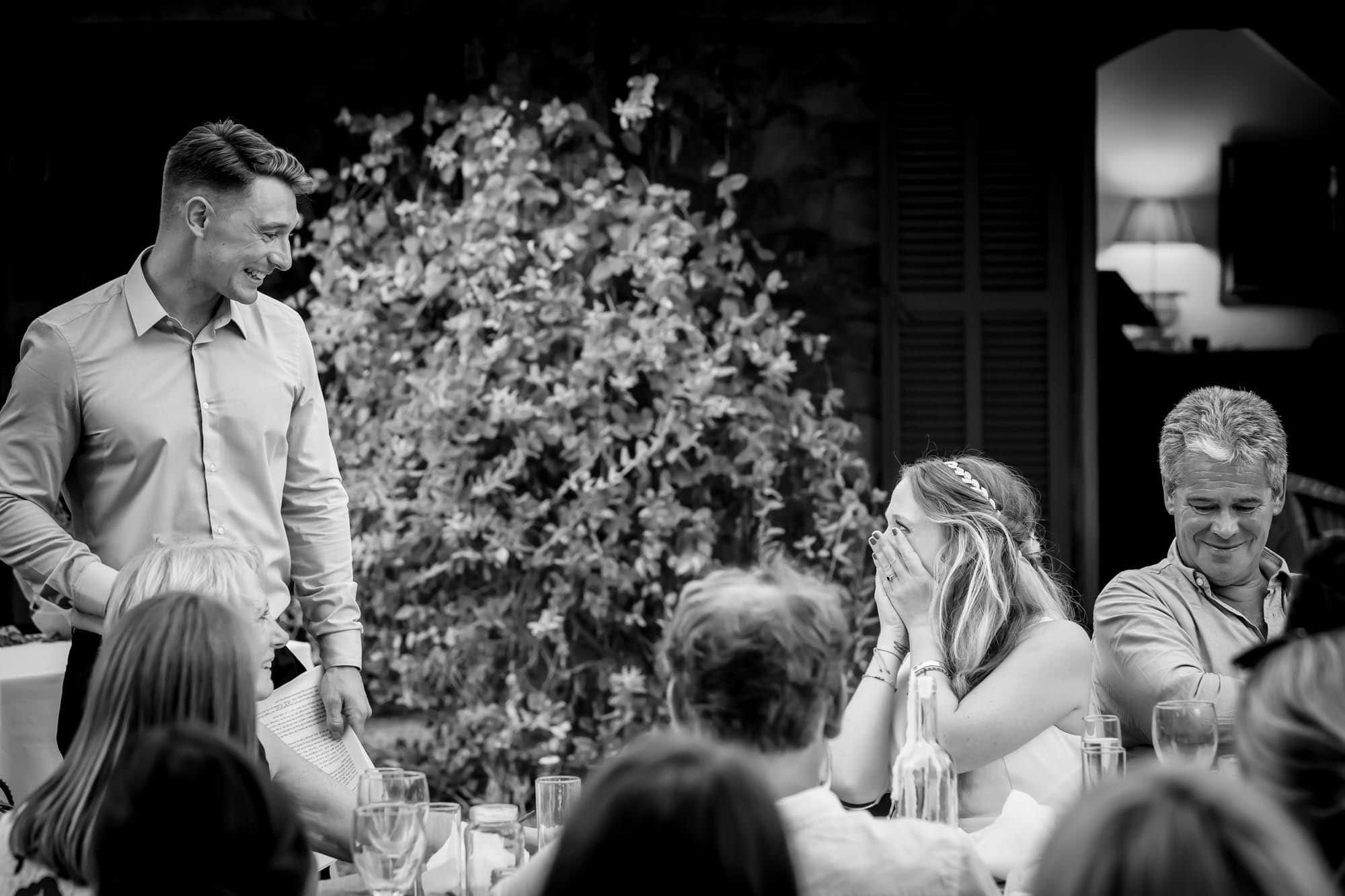 Cathy and Ben share a loving look during the wedding speeches at their Mallorca finca wedding