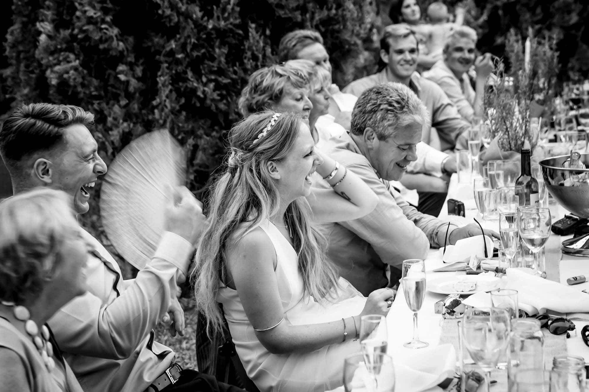 Everyone laughs during the best man's speech at a Mallorca wedding
