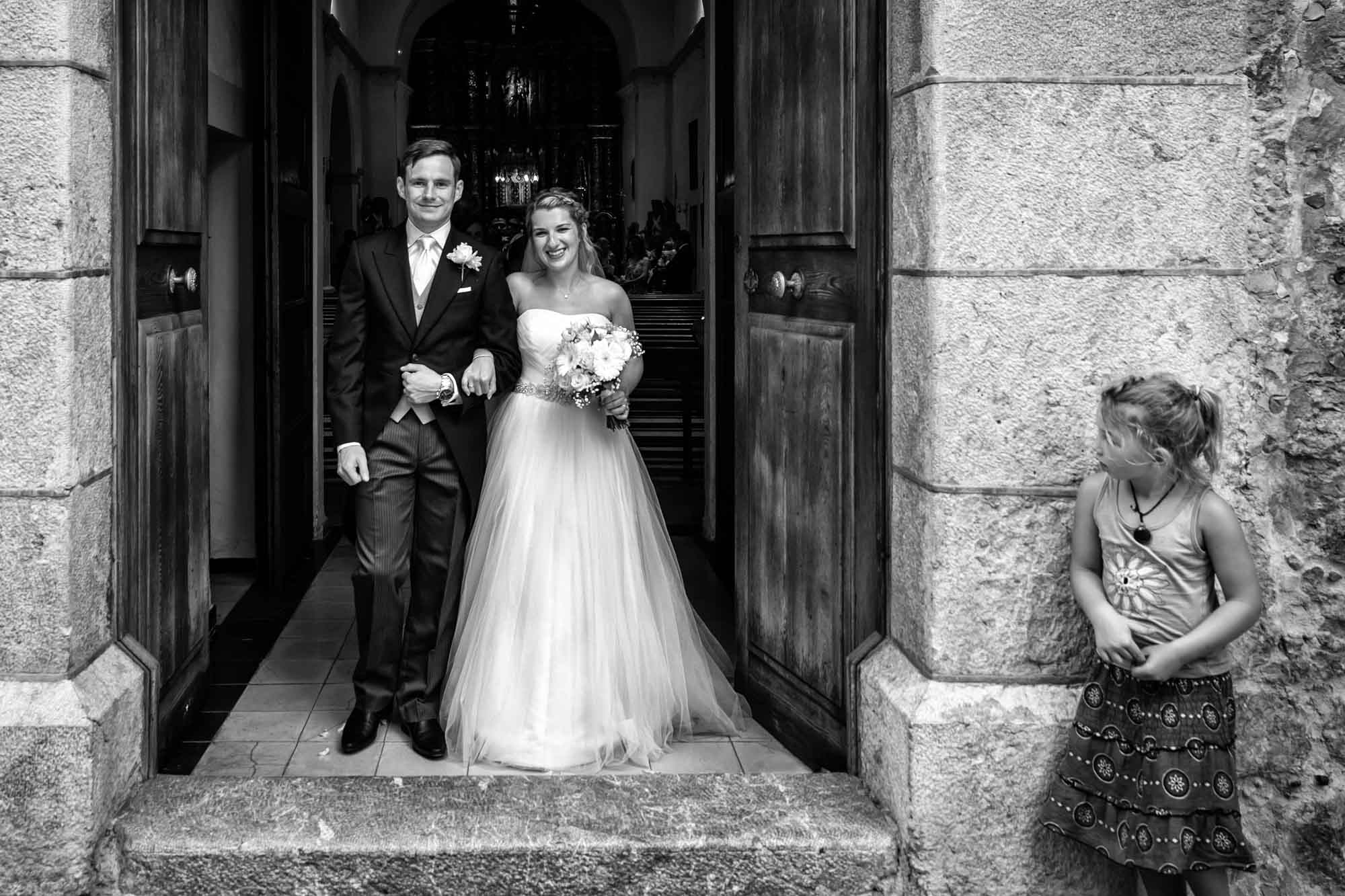 Bride and groom exiting Fornalutx church after their Mallorca wedding