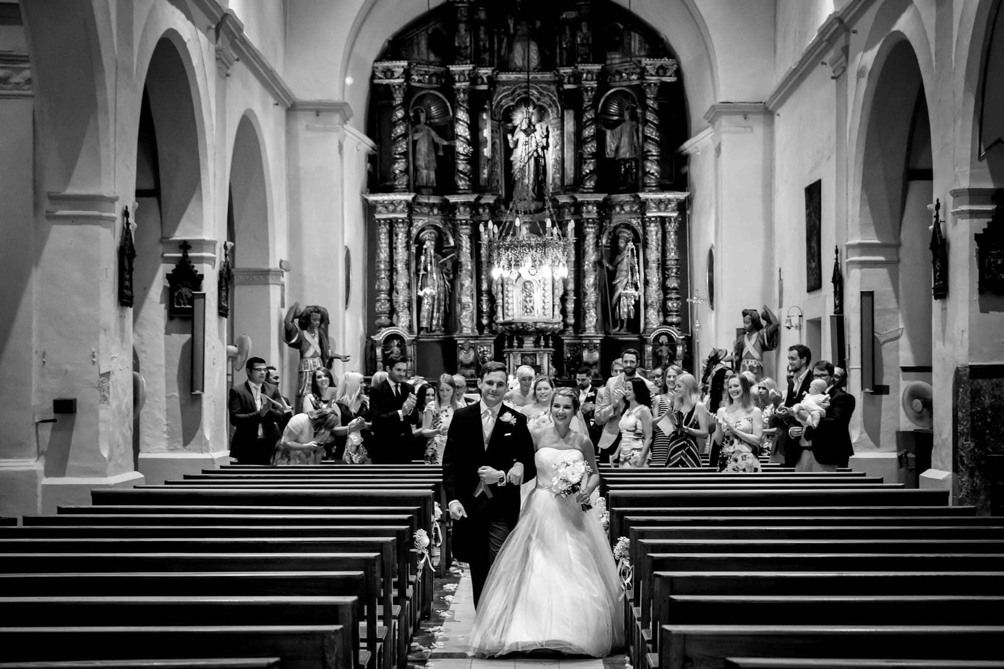 Bride and groom leaving their wedding ceremony in Fornalutx church
