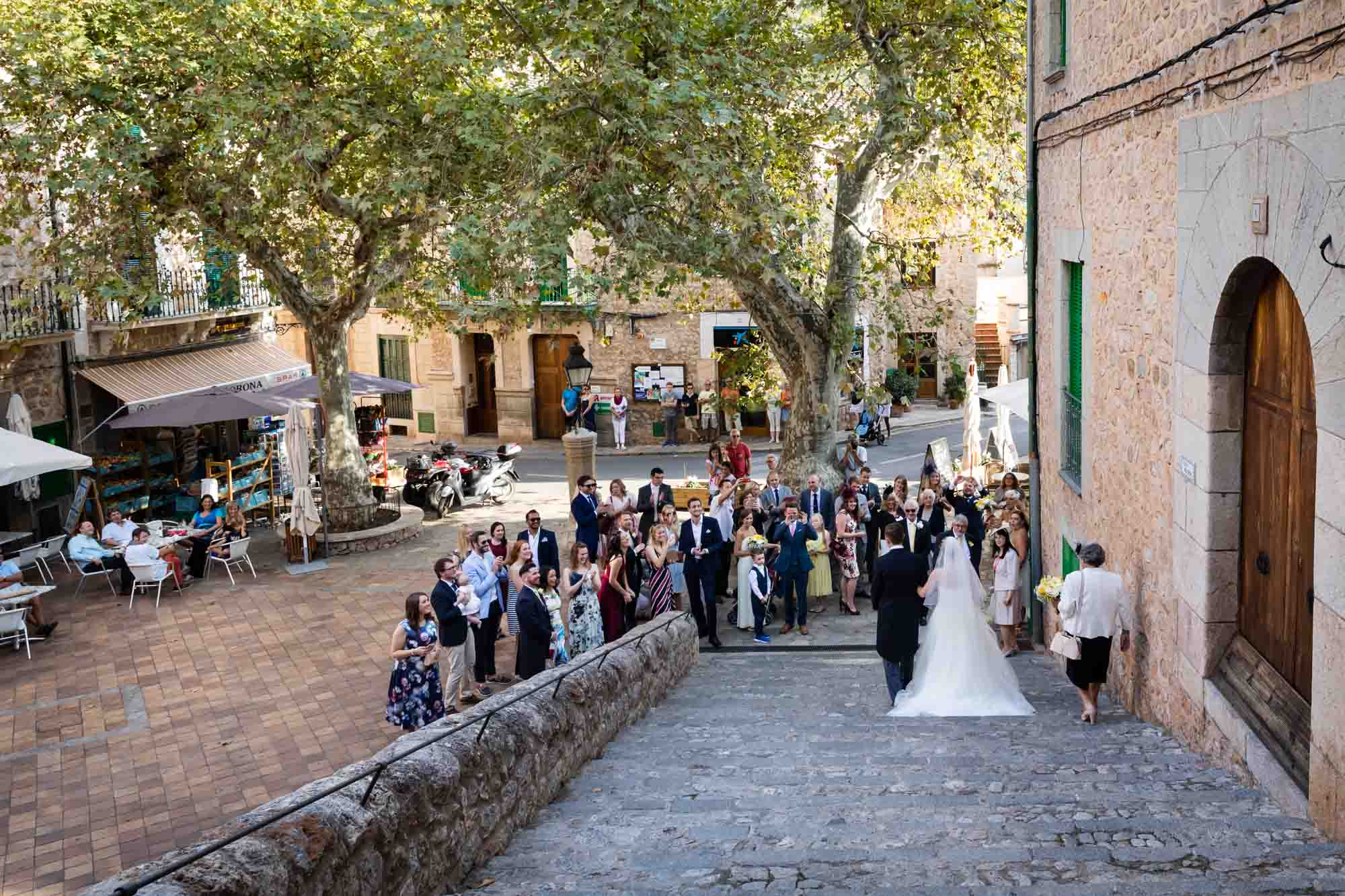 Bride and groom meeting guests in Plaza Major in Fornalutx after their Mallorca wedding