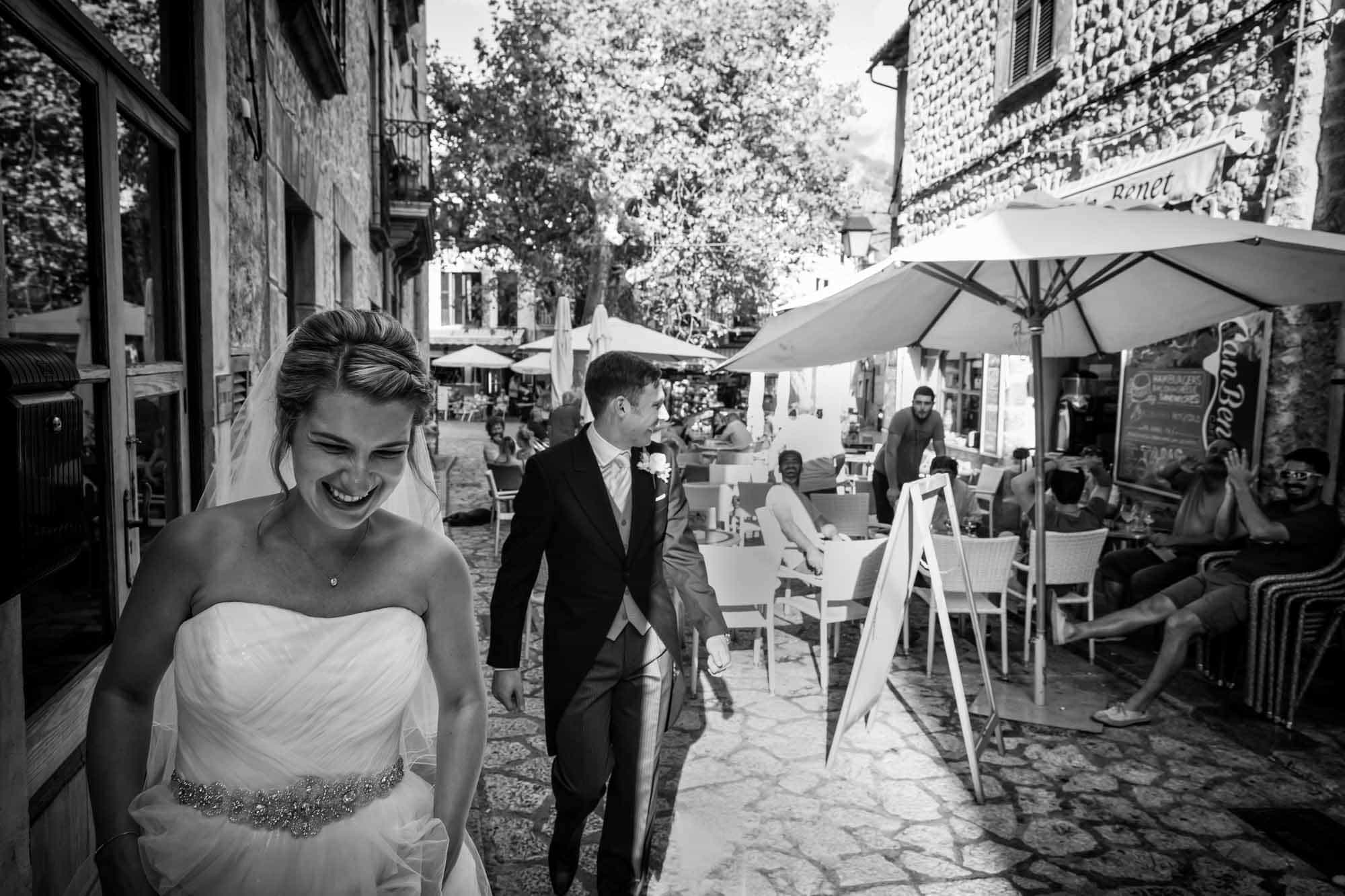 Cheers for the bride and groom after their Mallorca destination wedding by destination wedding photographer Graham Warrellow