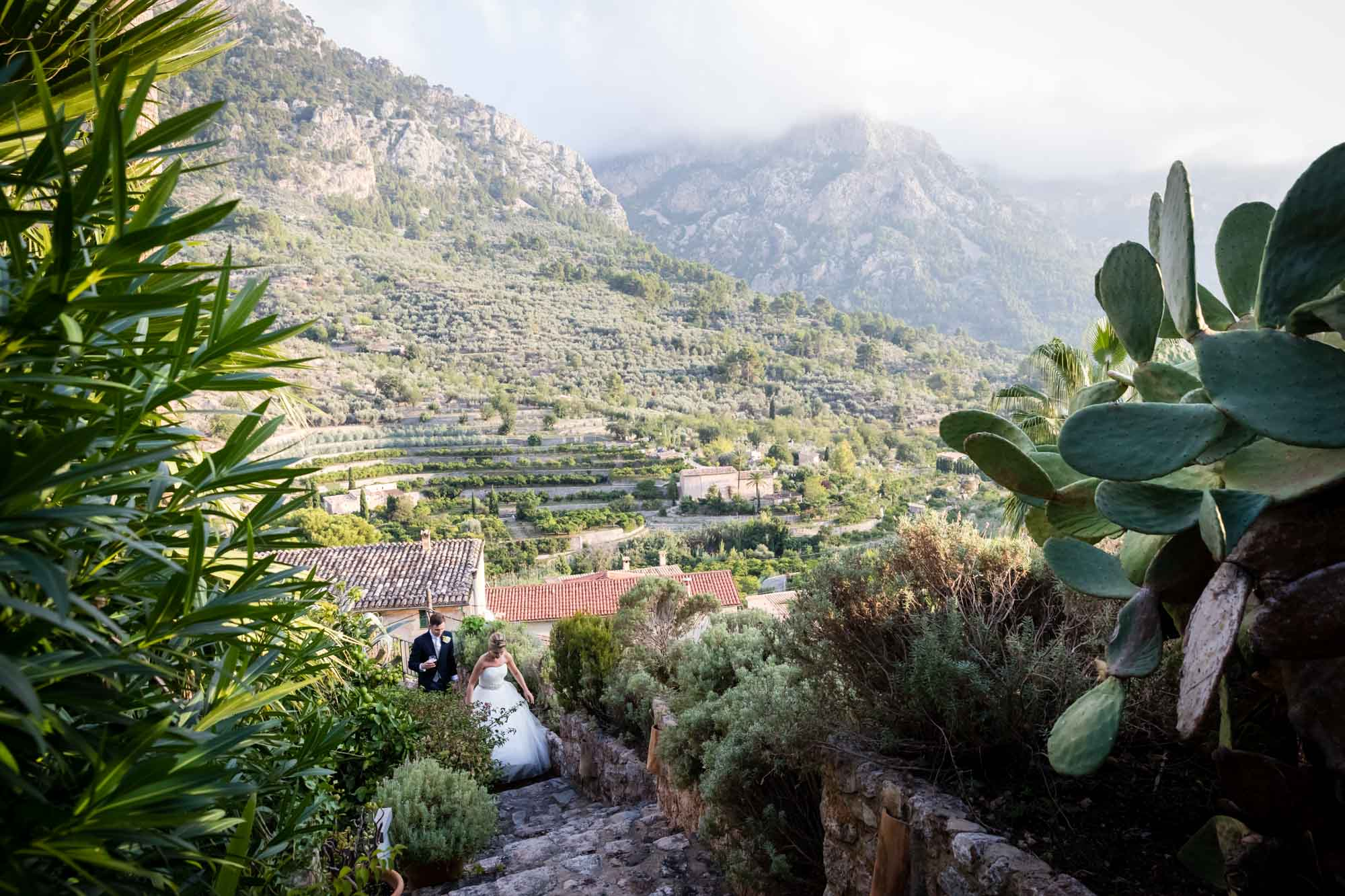 A beautiful view across the valley in Fornalutx as the bride and groom walk to their wedding breakfast at Hotel Can Vedera in Mallorca