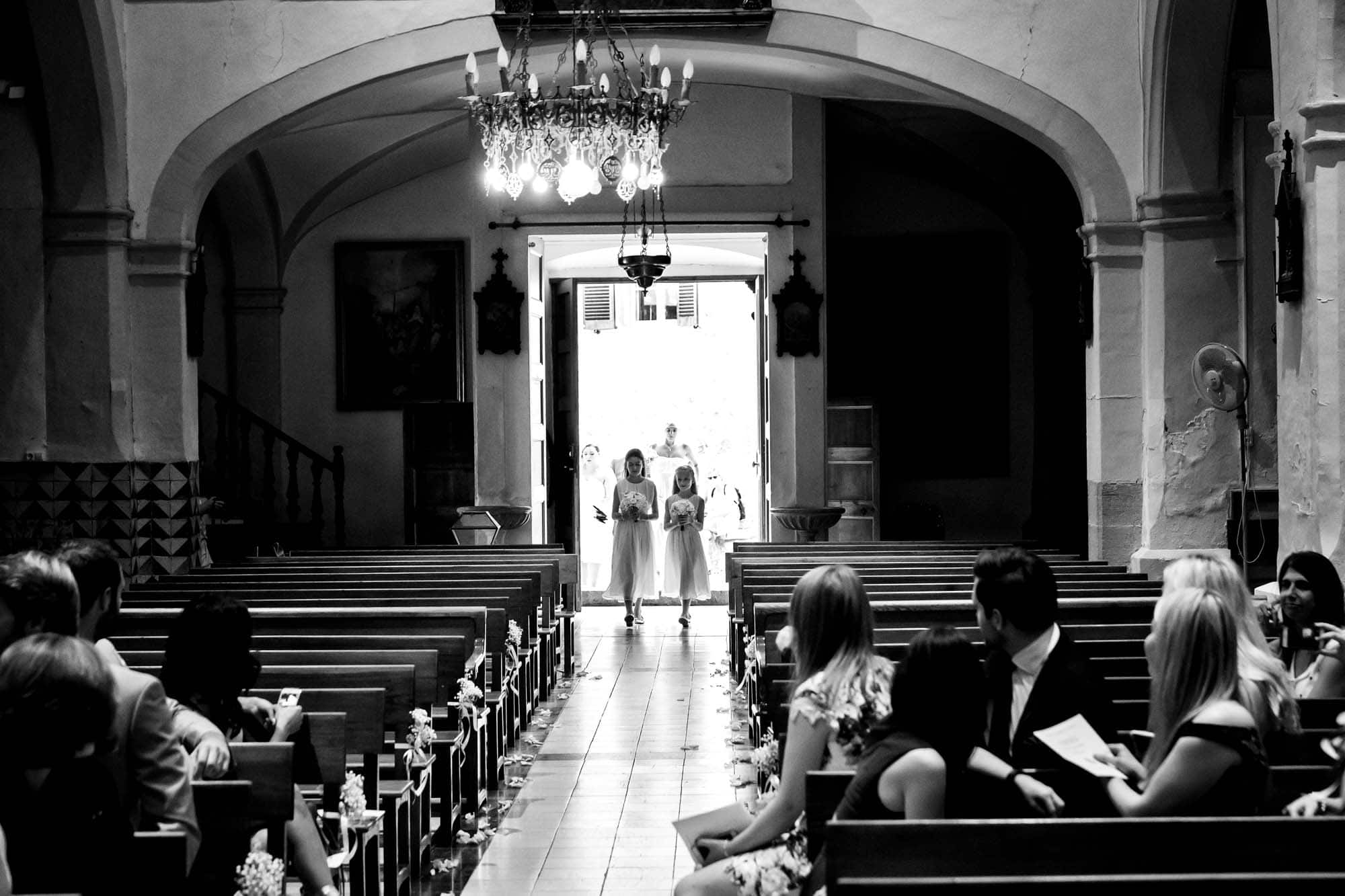 The flower girls enter the church in Fornalutx, Mallorca