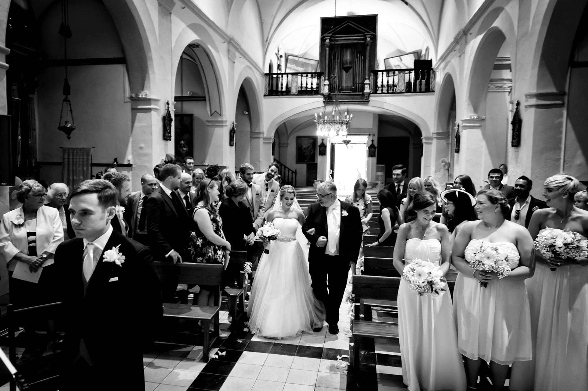 The bride approaches the groom in the church in Fornalutx