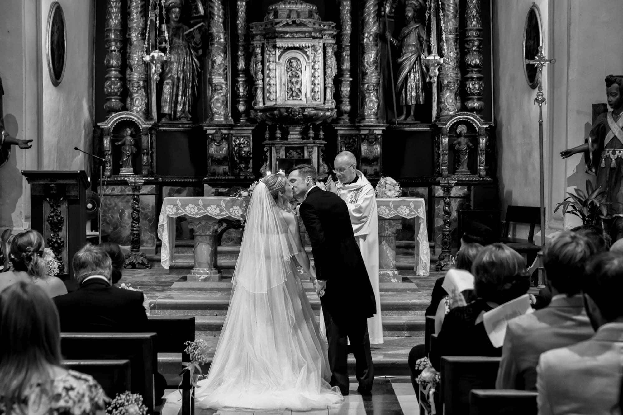 The first kiss after their marriage at Fornalutx Church in Mallorca