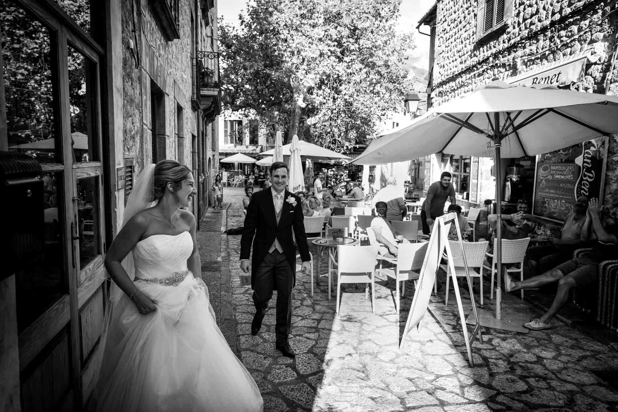 A cheer for the bride and groom after their Mallorca wedding