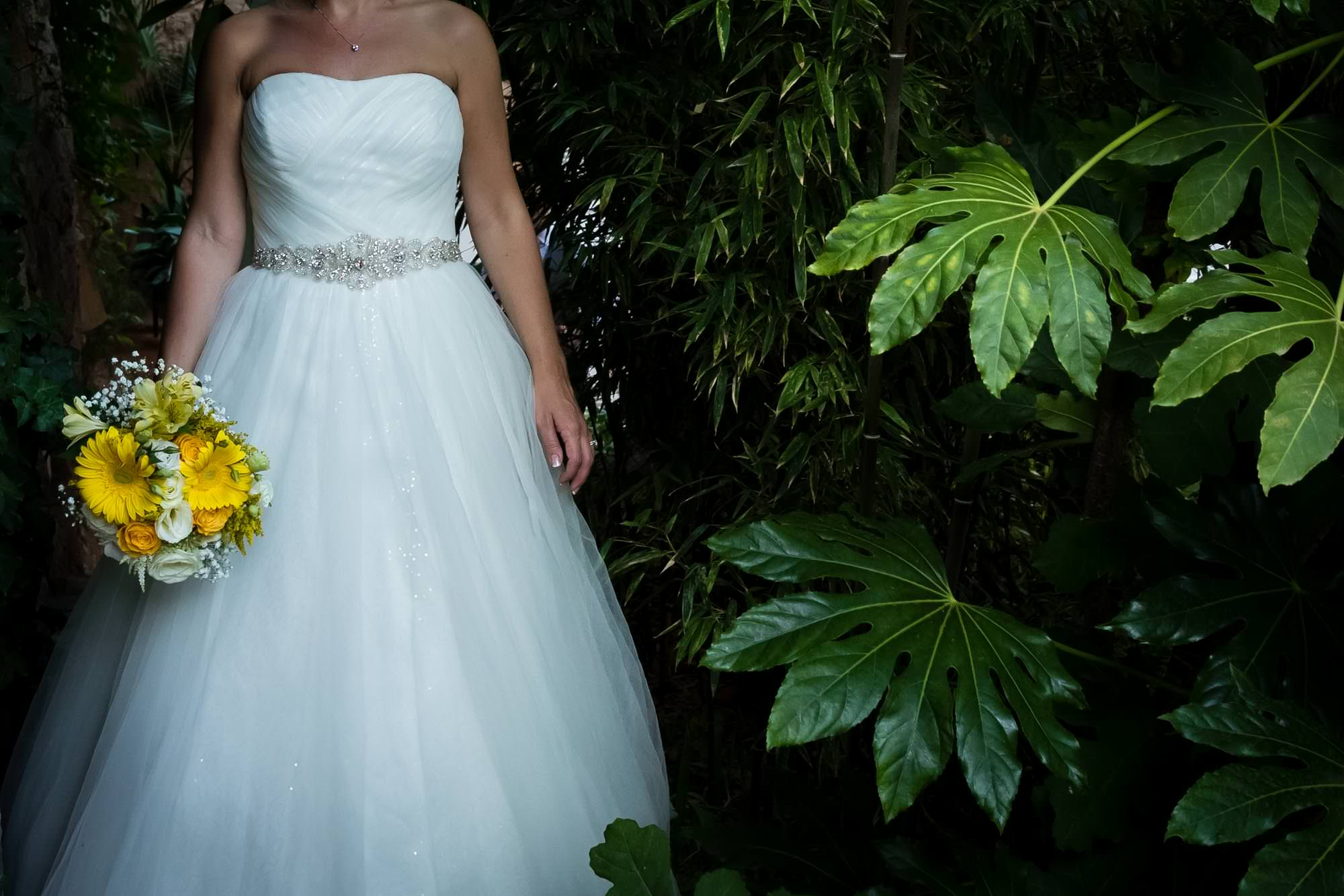 The bridal dress and beautiful flowers at Hotel Can Vedera in Mallorca by Mallorca destination wedding photographer Graham Warrellow