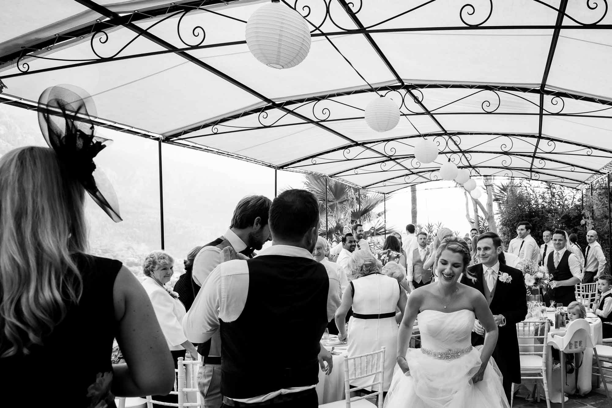 The bride and groom enter the terrace at the beautiful boutique hotel Can Vedera in Fornalutx, Mallorca