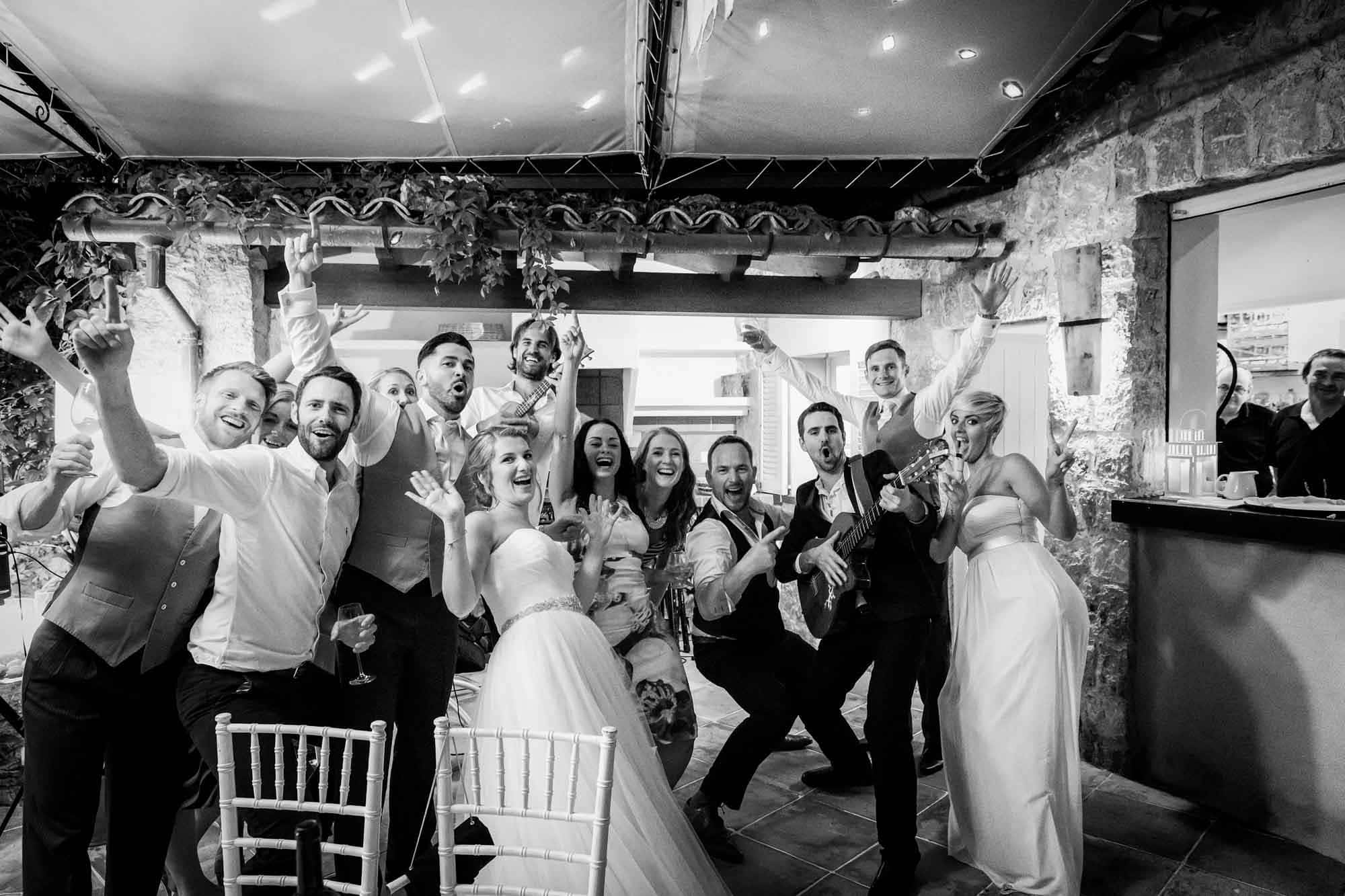 The bride and guest having fun with guests and the Muntaner Duo at their Fornalutx wedding