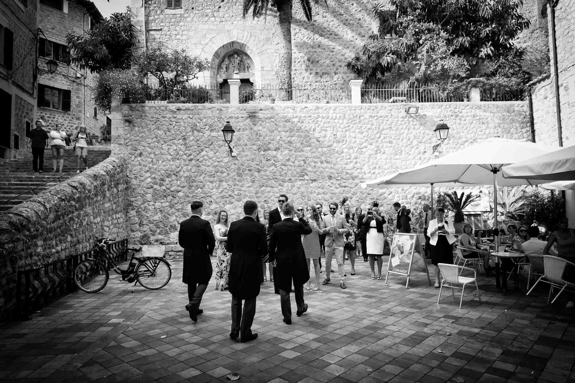 The groom meets his wedding guests in Plaza Major in Fornalutx