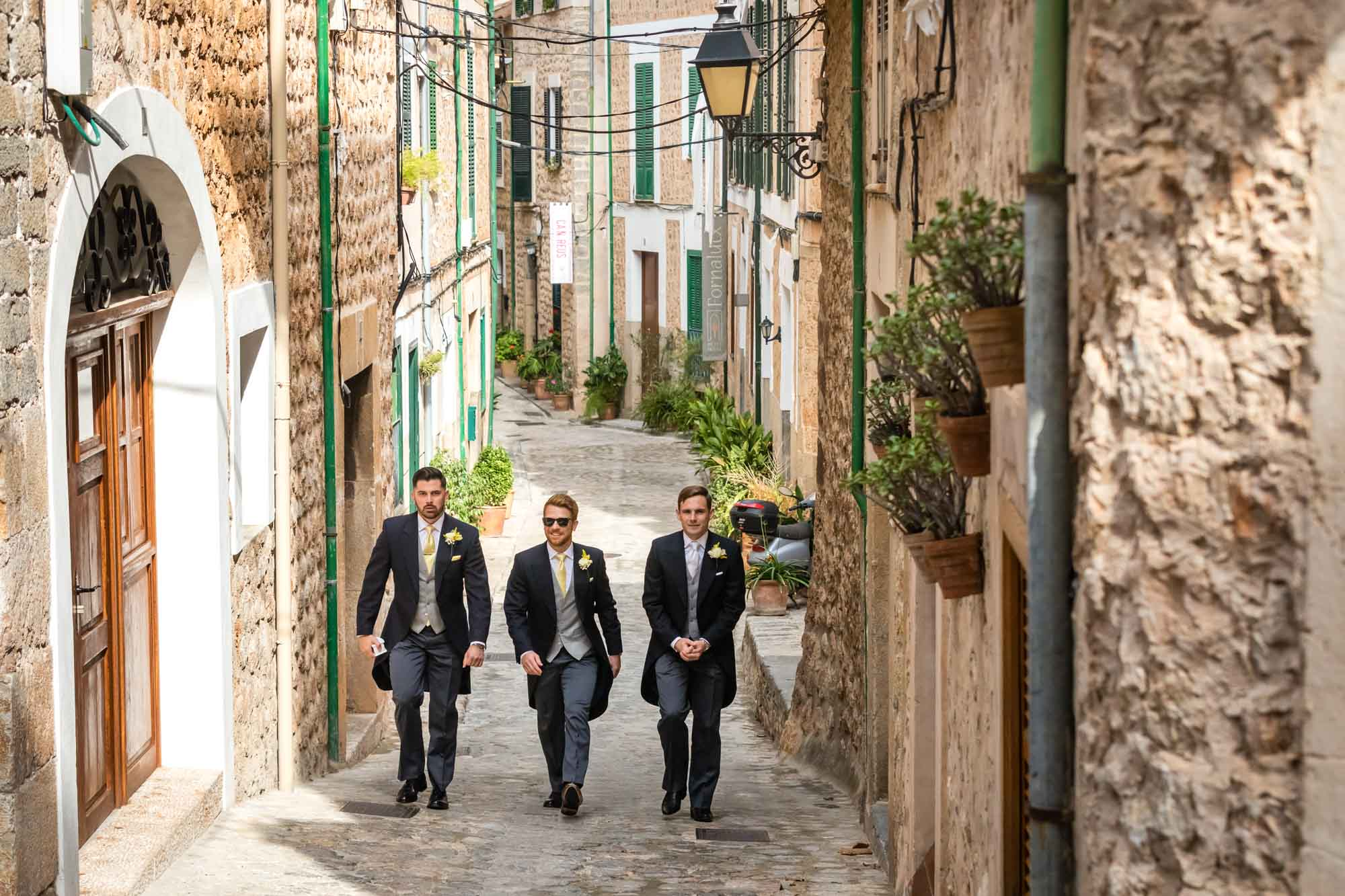 The groom and his bestmen leave Petit Hotel in Fornalutx, Mallorca