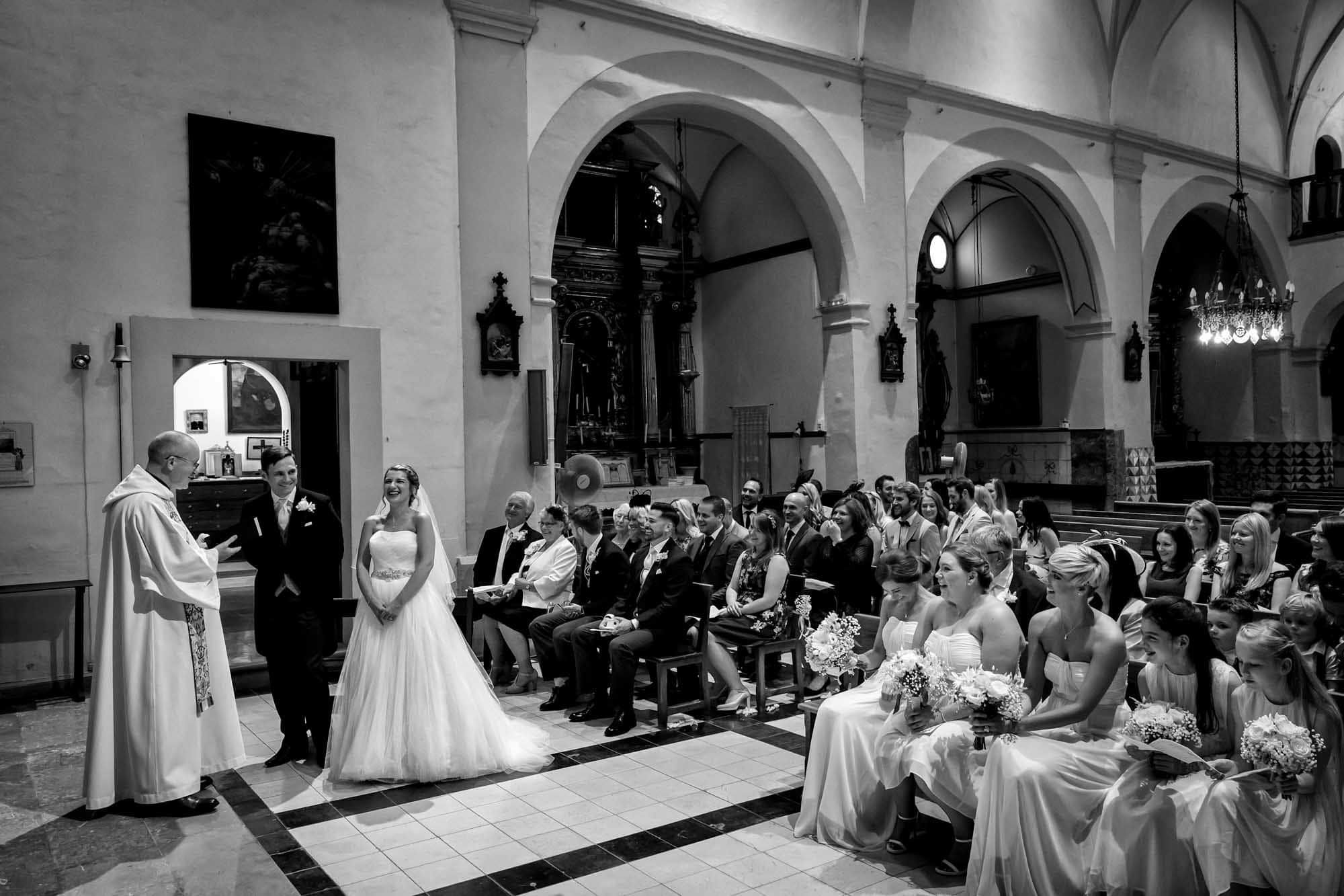 An amusing moment during the wedding ceremony at the church in Fornalutx