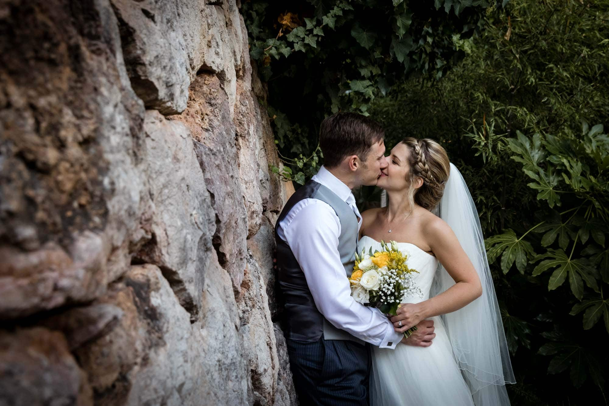 Bride and groom kissing in the garden at Hotel Can Verdera by Mallorca destination wedding photographer Graham Warrellow