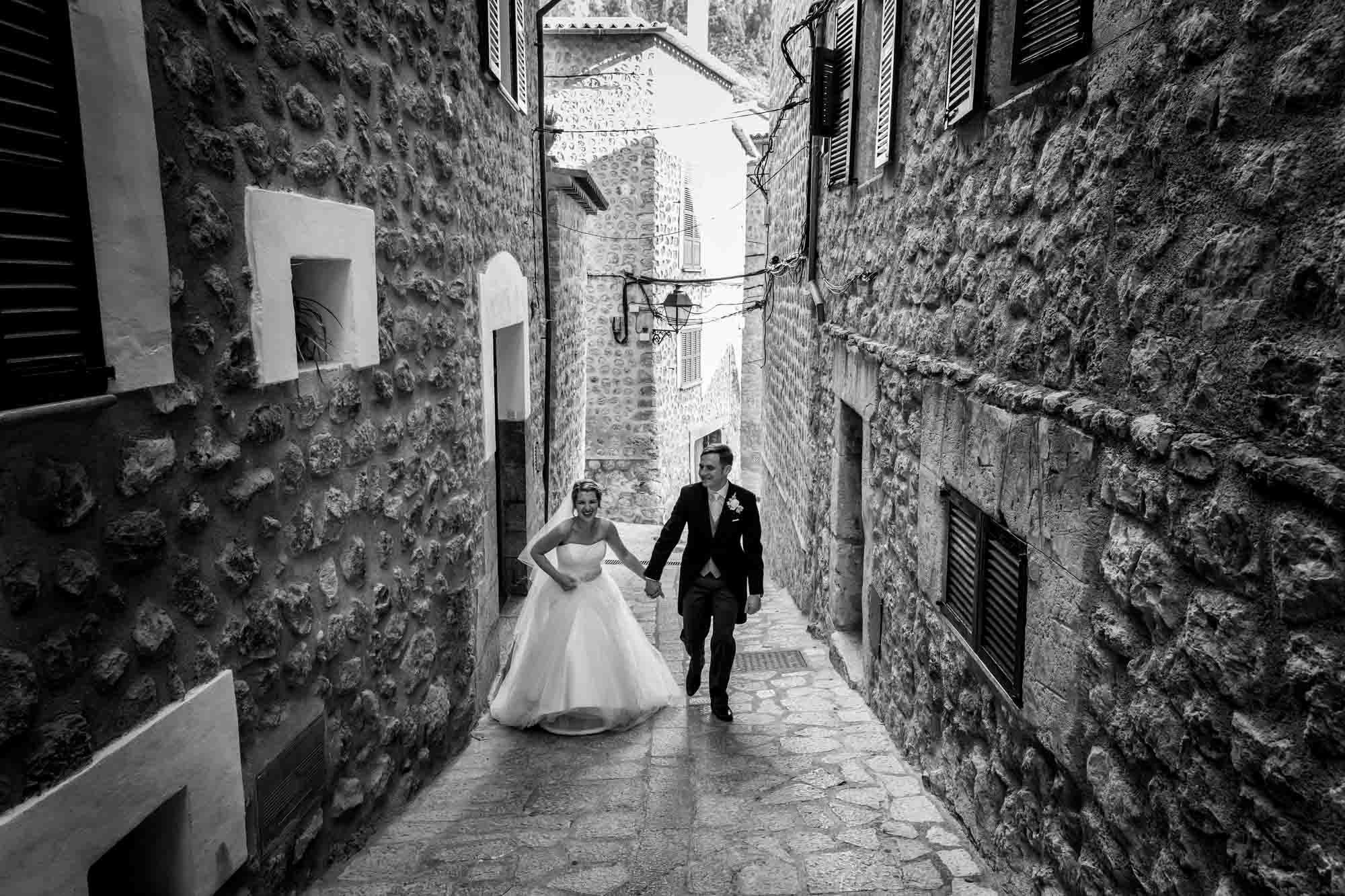 Bride and groom return to Can Verdera after their destination wedding in Fornalutx by Mallorca wedding photographer Graham Warrellow