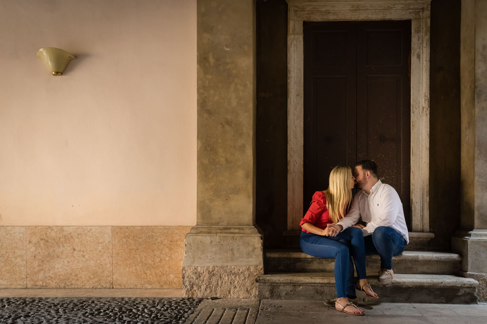 Romantic couple kiss in the back streets of Verona old town