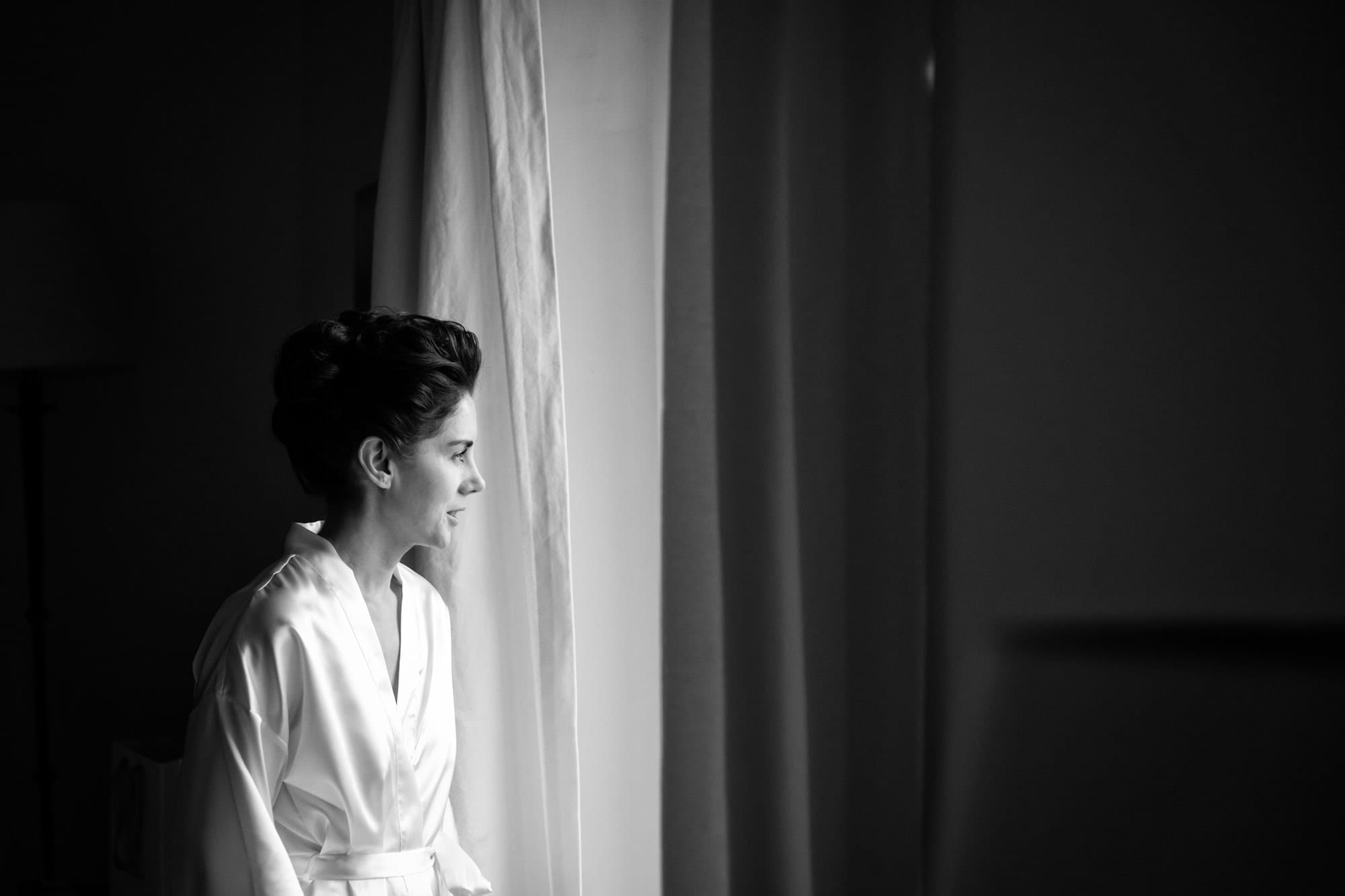 The bride looks out of window at Pedruxella Gran