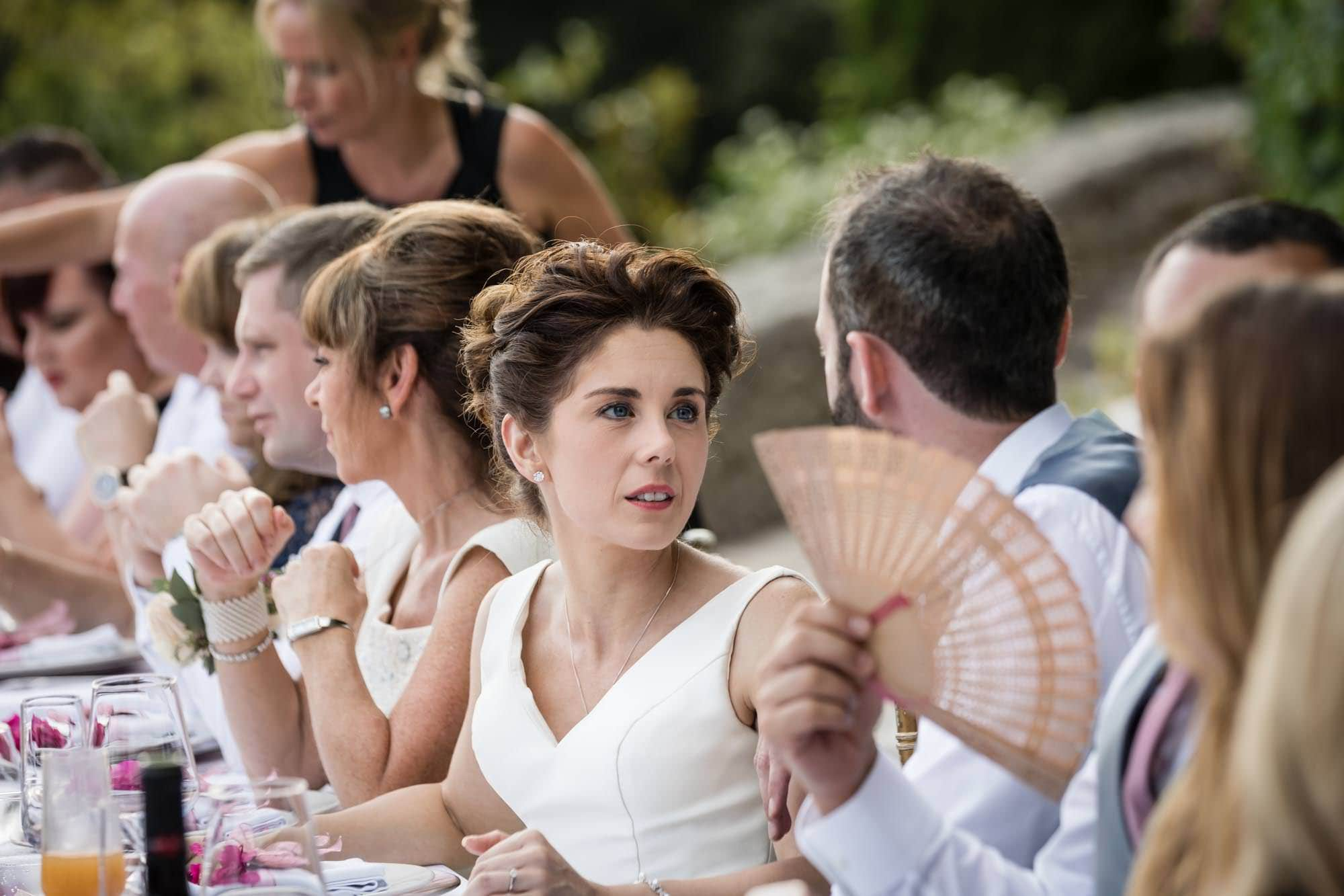 Beautiful bride lovingly looks at her new husband