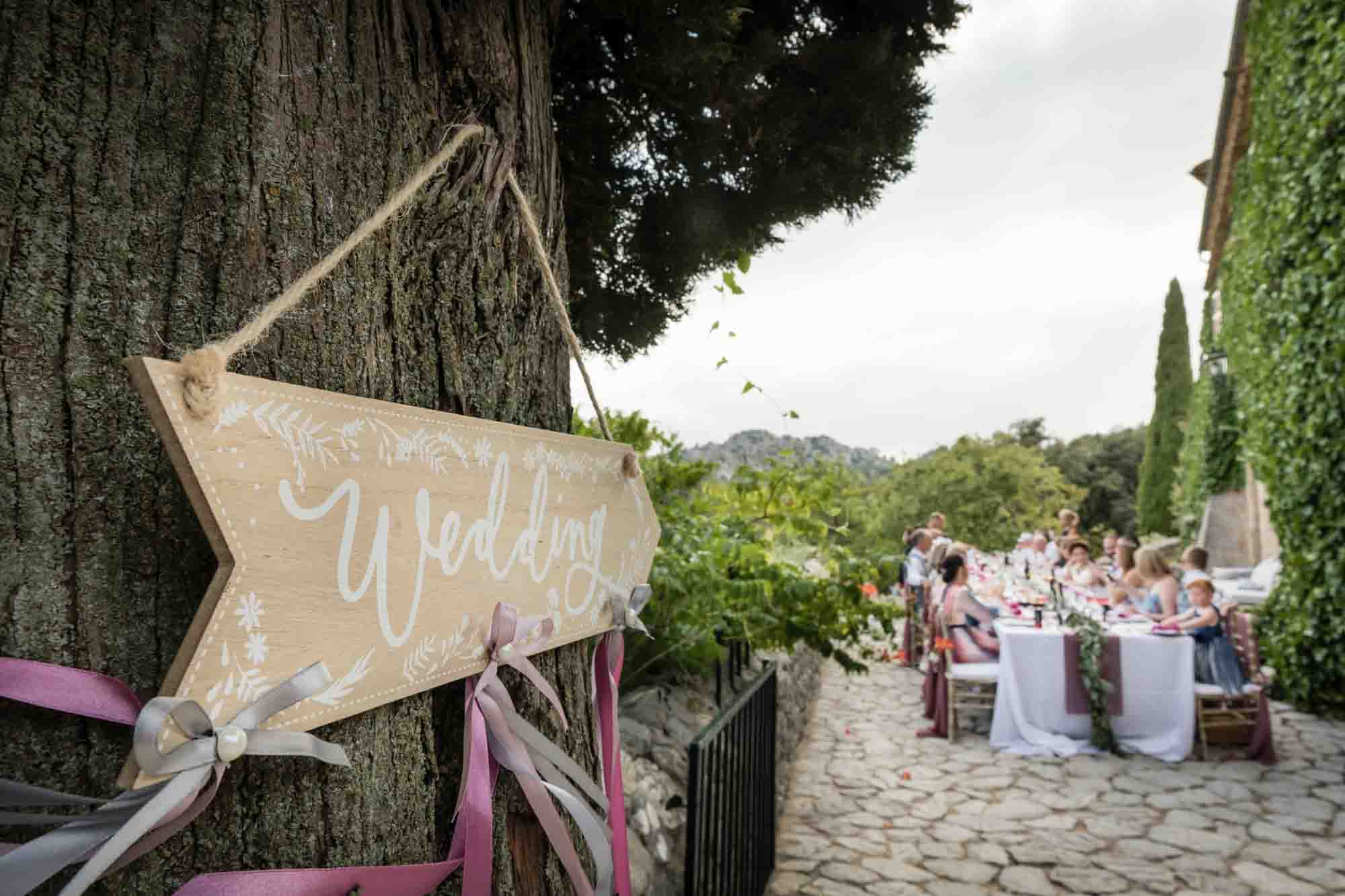 Guests enjoy a relaxed meal at an outdoor finca wedding