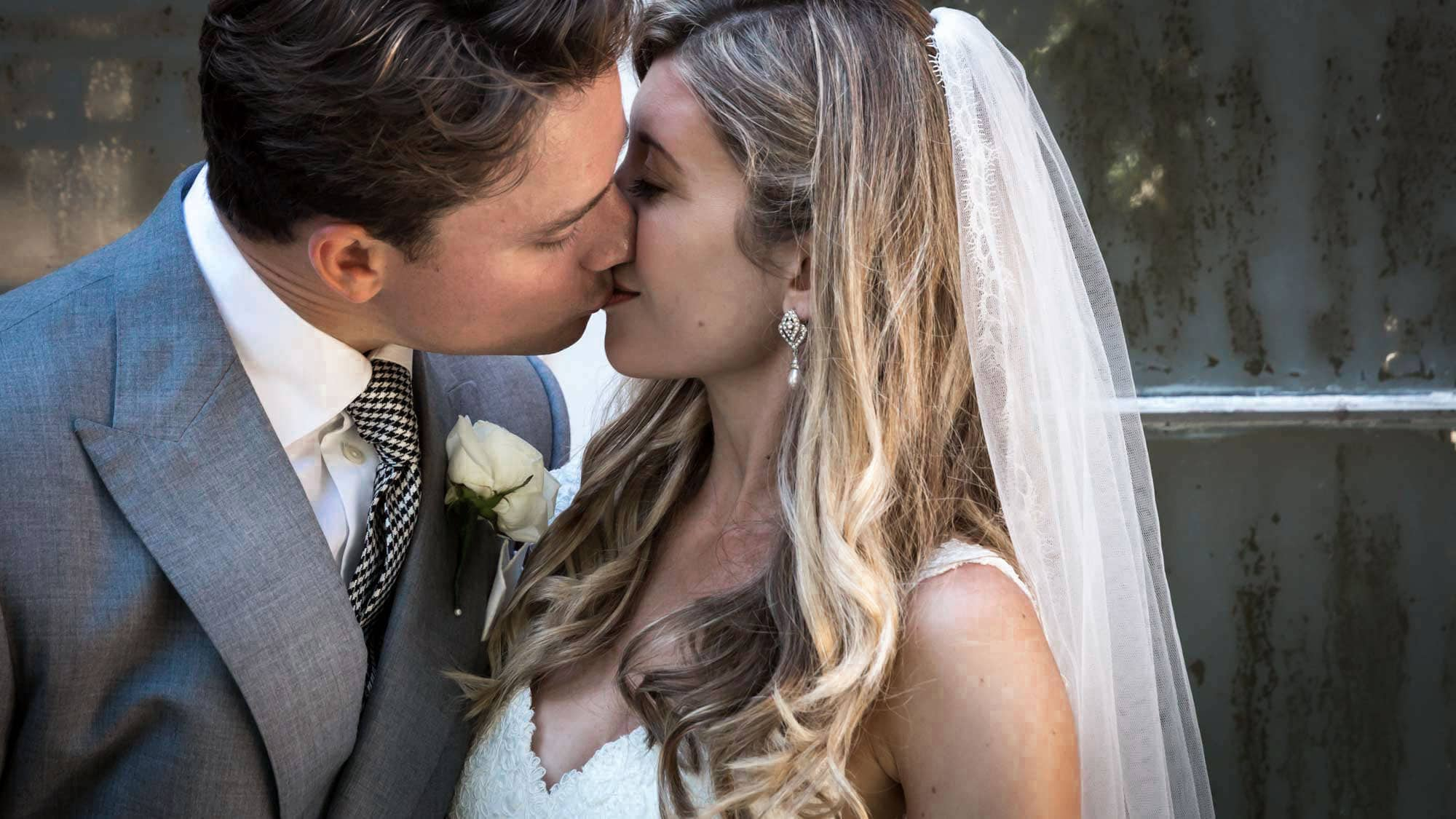 Bride and groom kiss after their Somerset wedding