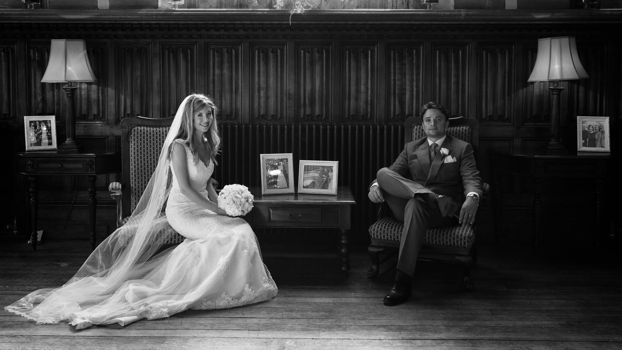 Bride and groom sit in the hall at St Audries Park