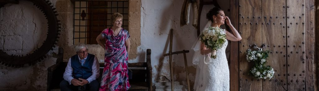 The bride's grandparents look on proudly as the beautiful bride awaits her guests at Son Termes in Mallorca